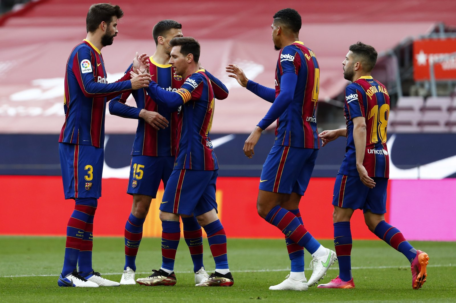 Barcelona's Lionel Messi celebrates with teammates scoring the opening goal during the Spanish La Liga match against Celta at the Camp Nou, Barcelona, Spain, May. 16, 2021. (AP Photo)