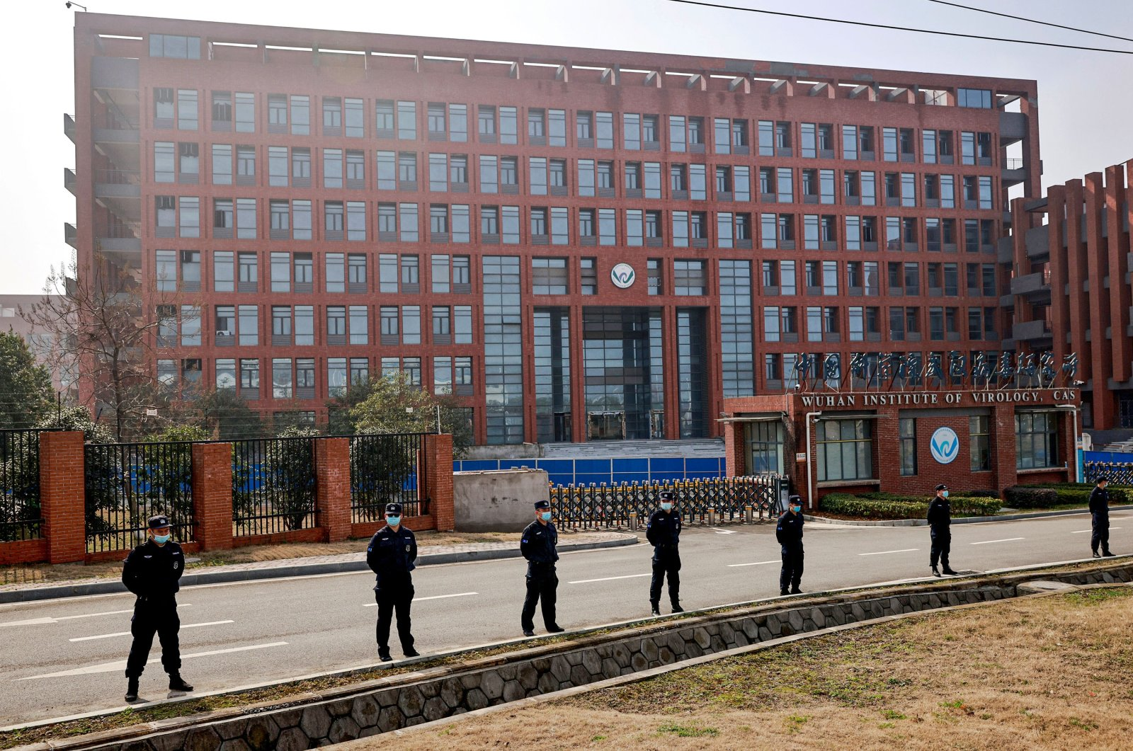 Security personnel keep watch outside the Wuhan Institute of Virology during the visit by the World Health Organization (WHO) team tasked with investigating the origins of the coronavirus, inWuhan, Hubei province, China, Feb. 3, 2021. (Reuters Photo)