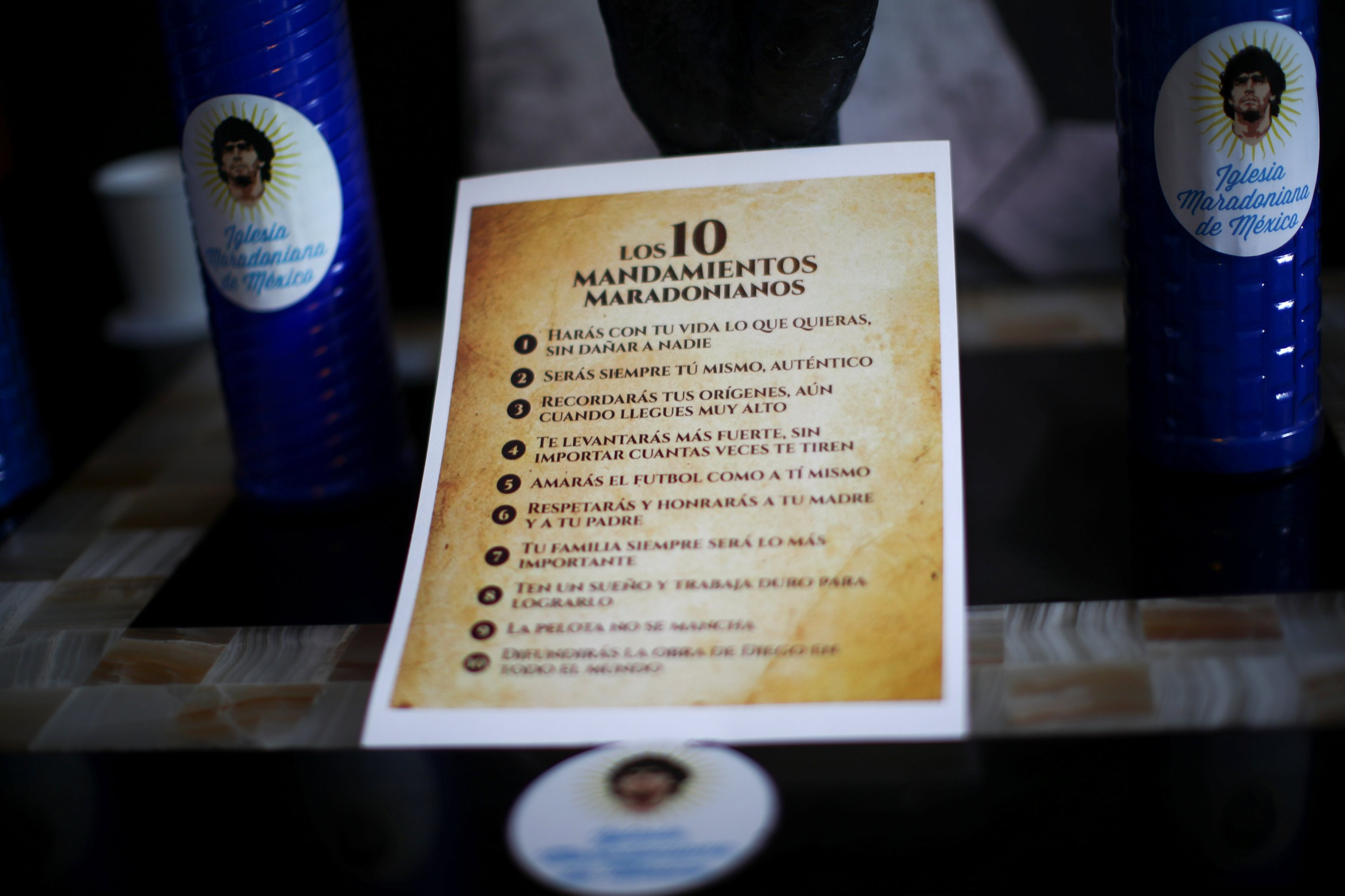 A sheet with 'commandments' is pictured at the first Mexico's church in memory of football legend Diego Maradona in San Andres Cholula, in Puebla state, Mexico, July 14, 2021. (Reuters Photo)
