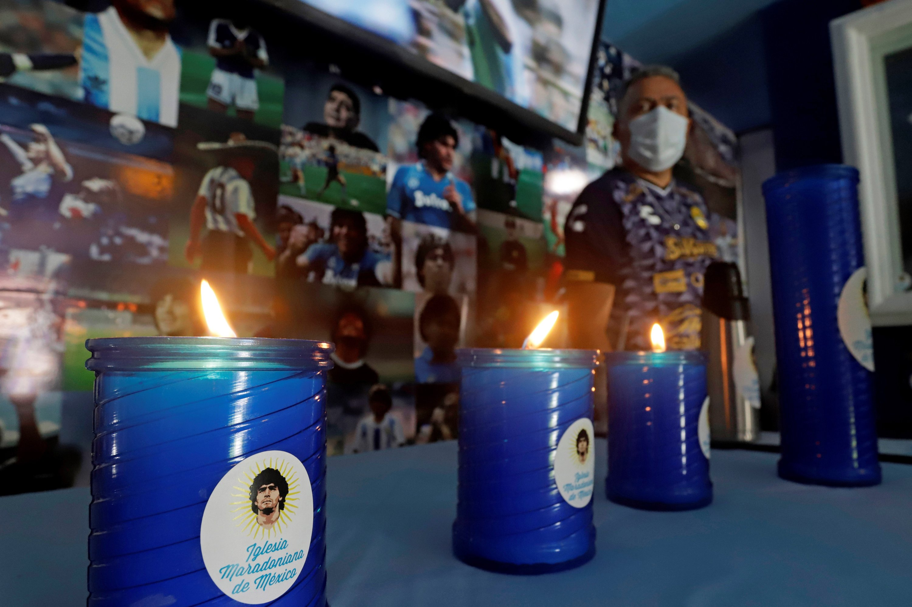 Candles with the photograph of Diego Maradona, in the municipality of San Andres Cholula, in Puebla, Mexico, July 07, 2021. (EPA Photo)