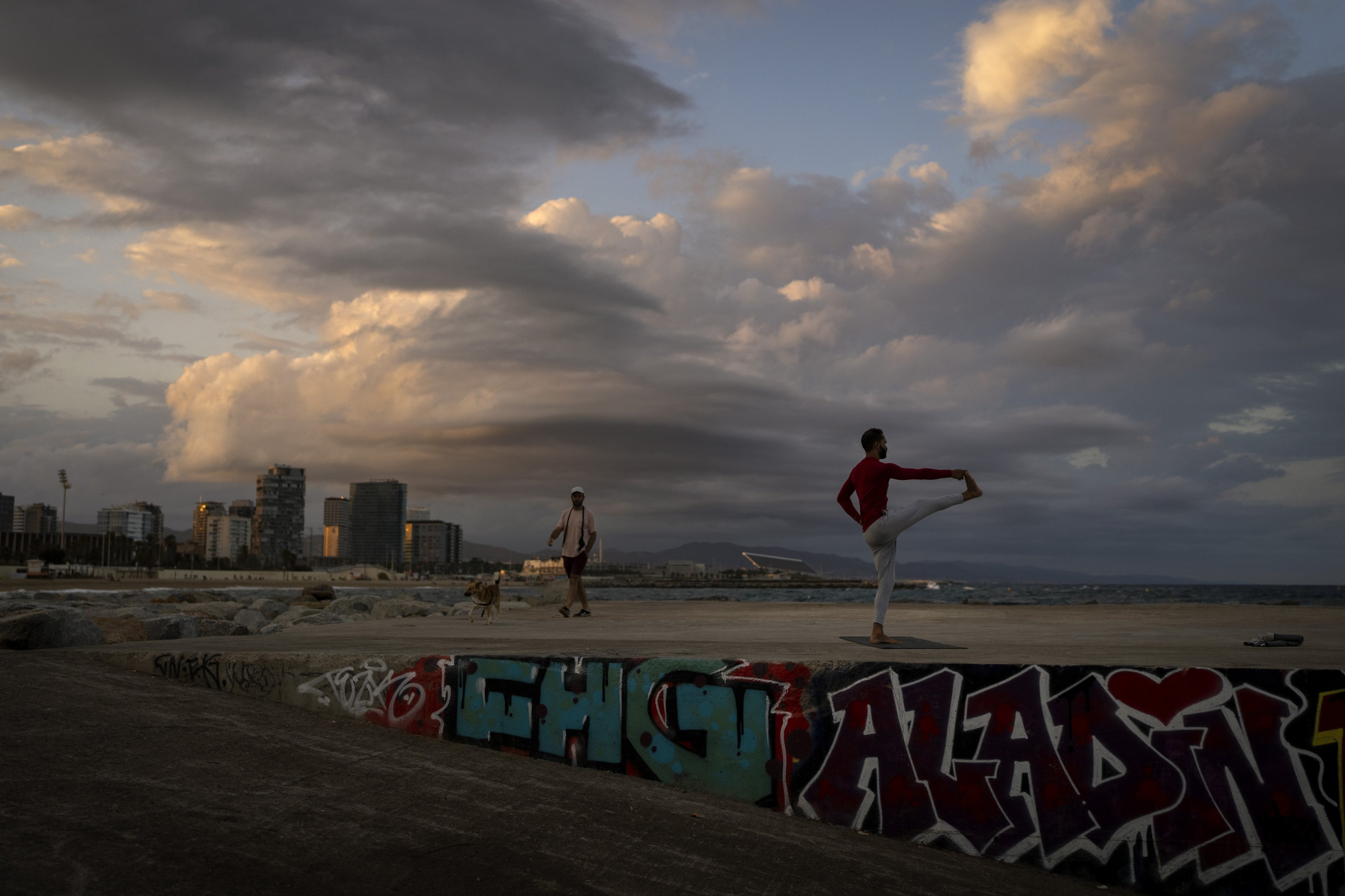 A man exercises during sunset in Barcelona, Spain, July 14, 2021. (AP Photo)