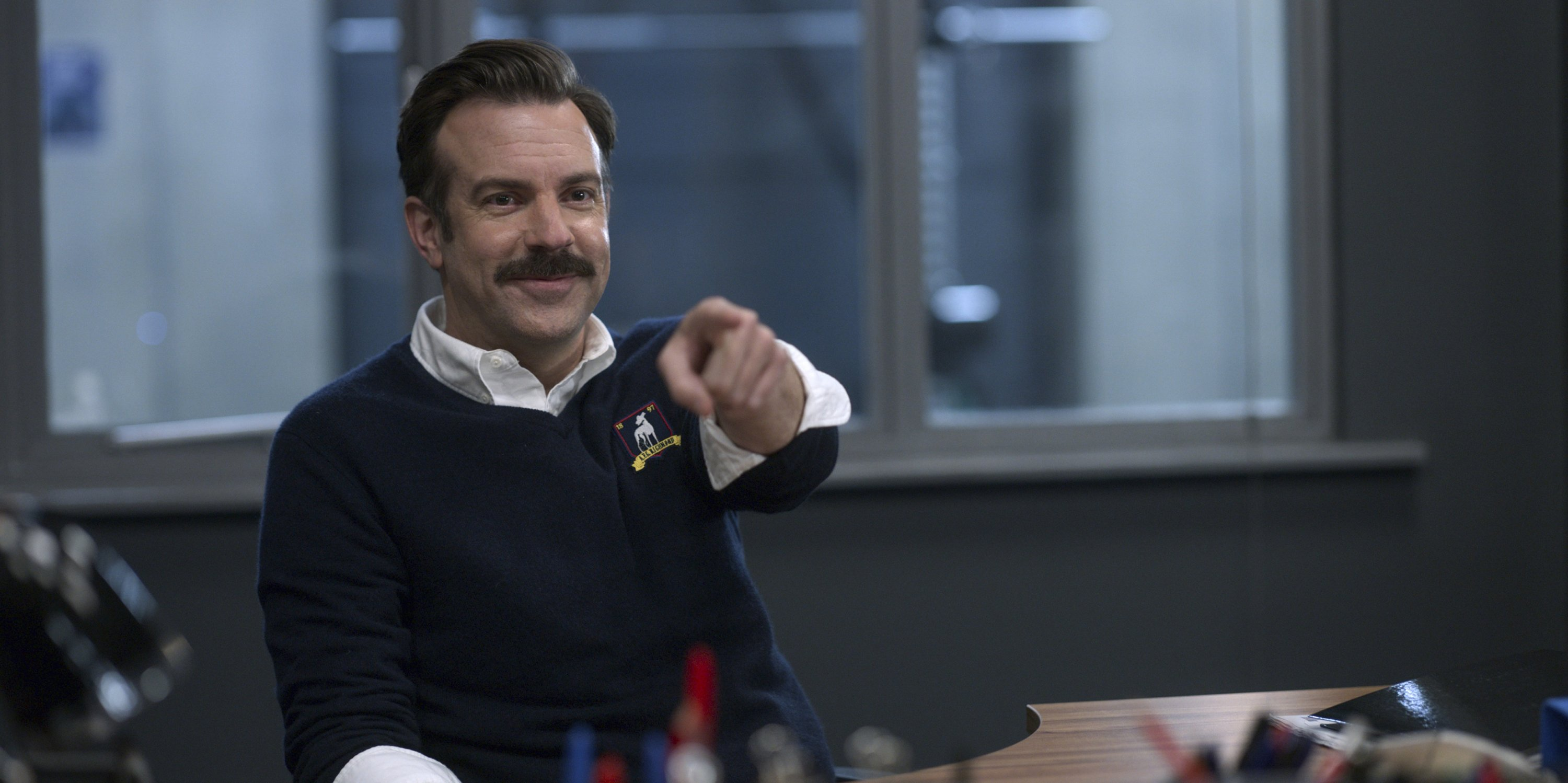 Jason Sudeikis, as Ted Lasso, points his finger, in a scene from the series 'Ted Lasso.' (Apple TV+ via AP)