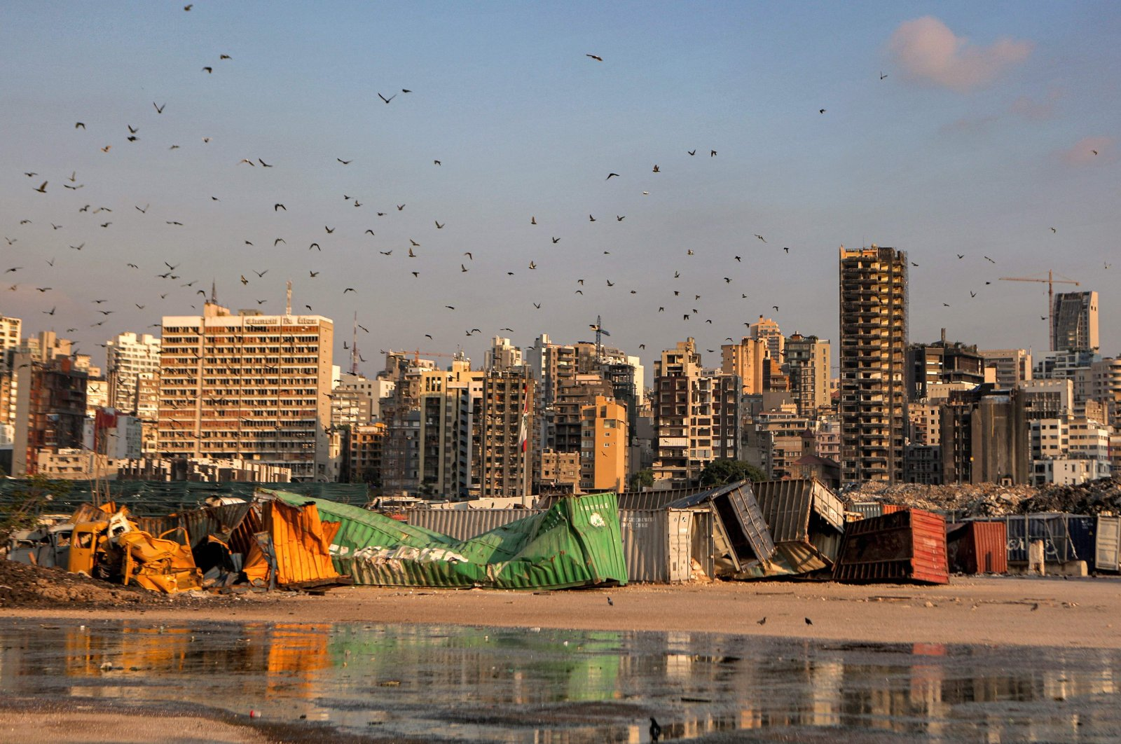 Pigeons fly over destroyed containers at the port of Beirut, Lebanon, July 14, 2021. (AFP Photo)