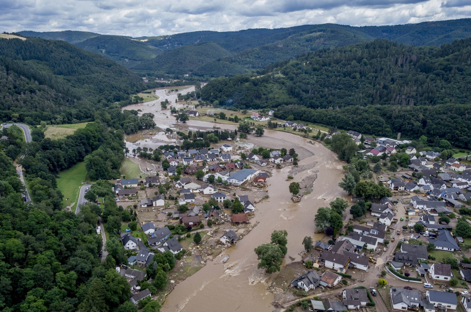 The Ahr river flows past houses destroyed by floods in Insul, Germany, July 15, 2021. (AP Photo)