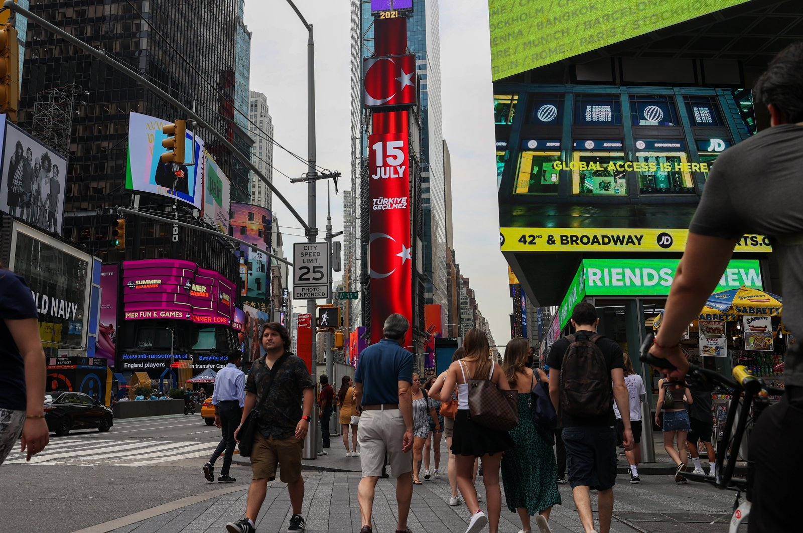"""Digital screens display """"Our heroes"""" and """"Victory of Democracy"""" as well as the Turkish flag at New York's Times Square, U.S., July 15, 2021 (AA Photo)"""