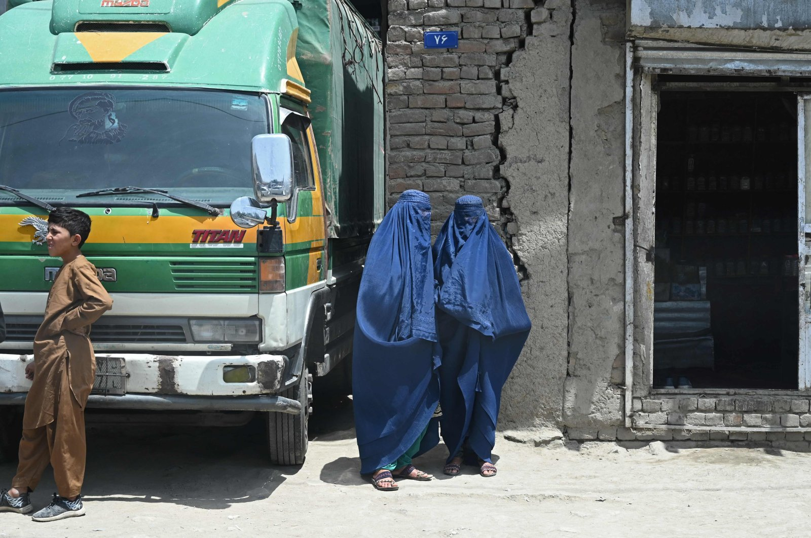 Afghan women and a boy stand outside a shop in the old quarters of Kabul, Afghanistan, July 12, 2021. (AFP Photo)