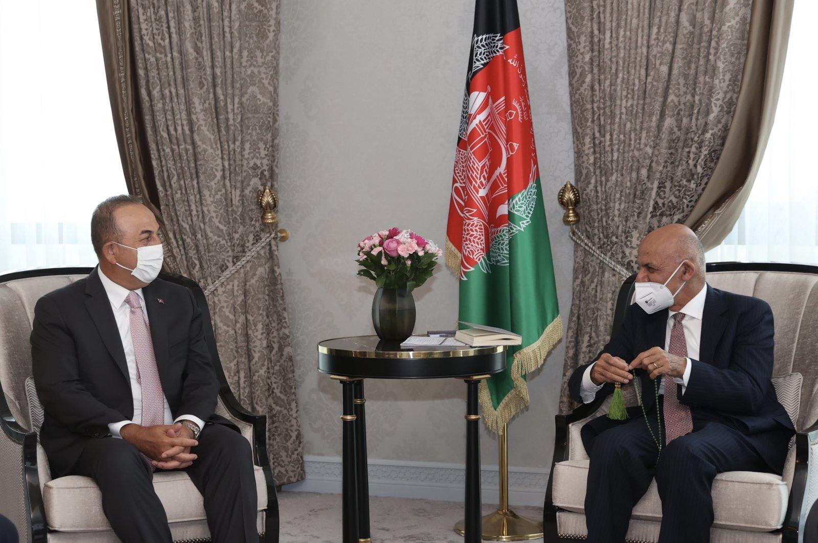 Foreign Minister Mevlüt Çavuşoğlu (L) talks to Afghan President Ashraf Ghani in Uzbekistan, July 15, 2021 (AA Photo)