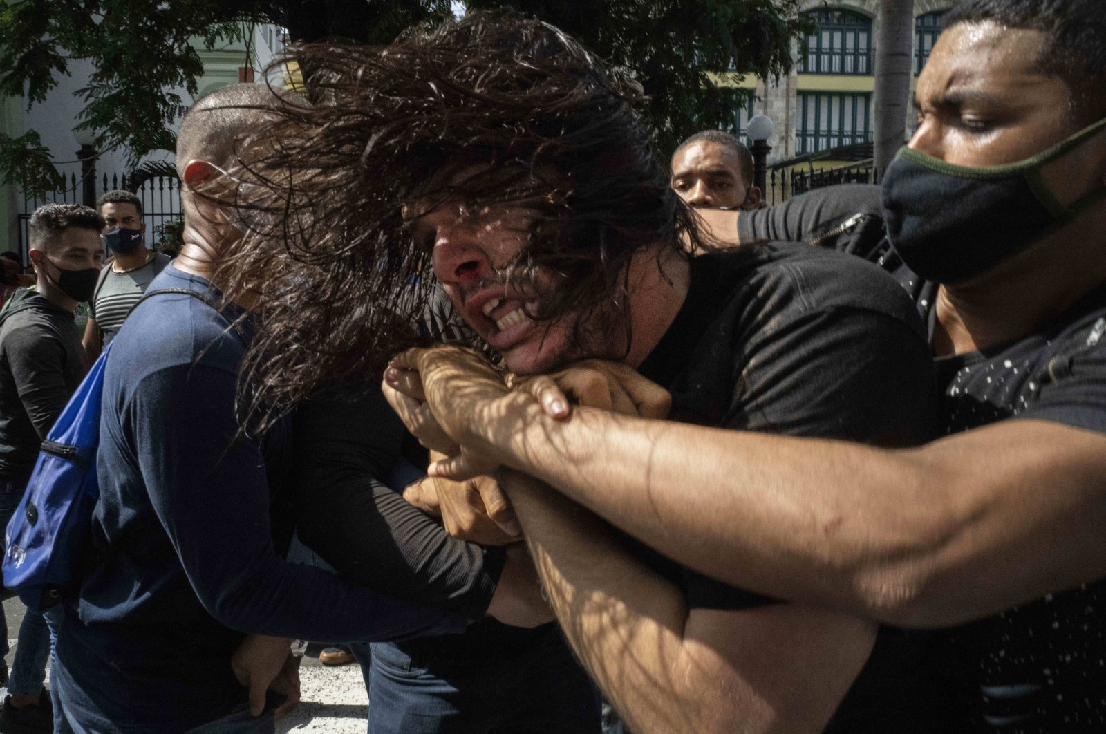 Plainclothes police detain an anti-government protester during a demonstration over high prices, food shortages and power outages, while some people also called for a change in the government, in Havana, Cuba, July 11, 2021. (AP Photo)