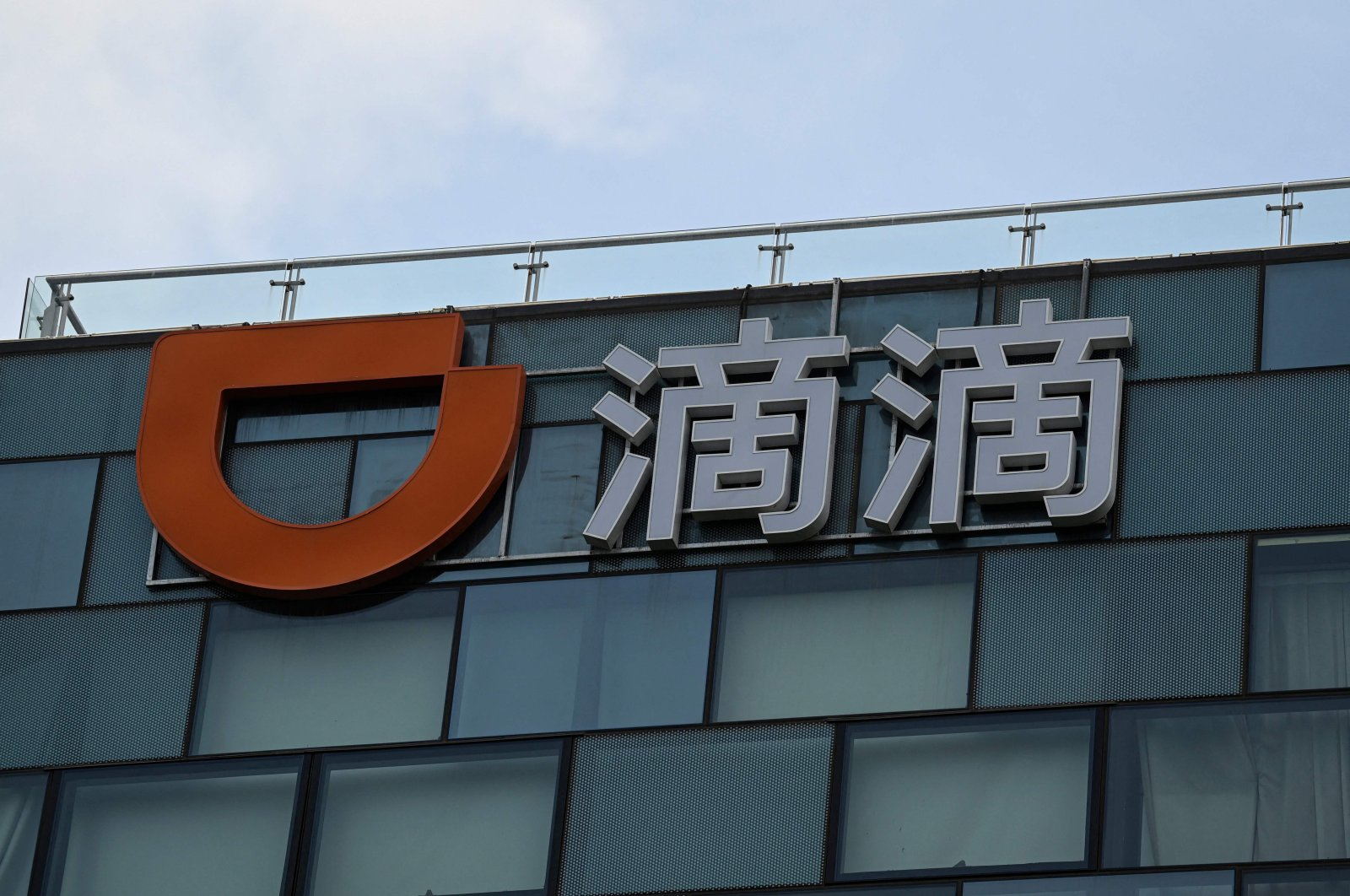 A logo of Chinese ride-hailing giant Didi at its headquarters in Beijing, China, July 2, 2021. (AFP Photo)