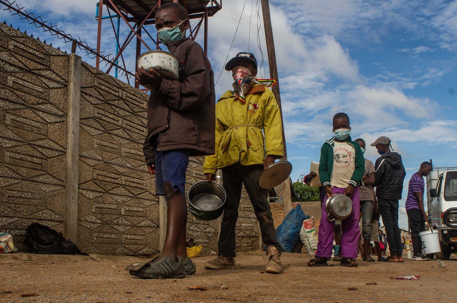Children queue for porridge in Harare, Zimbabwe, Dec. 31, 2020. (Getty Images)
