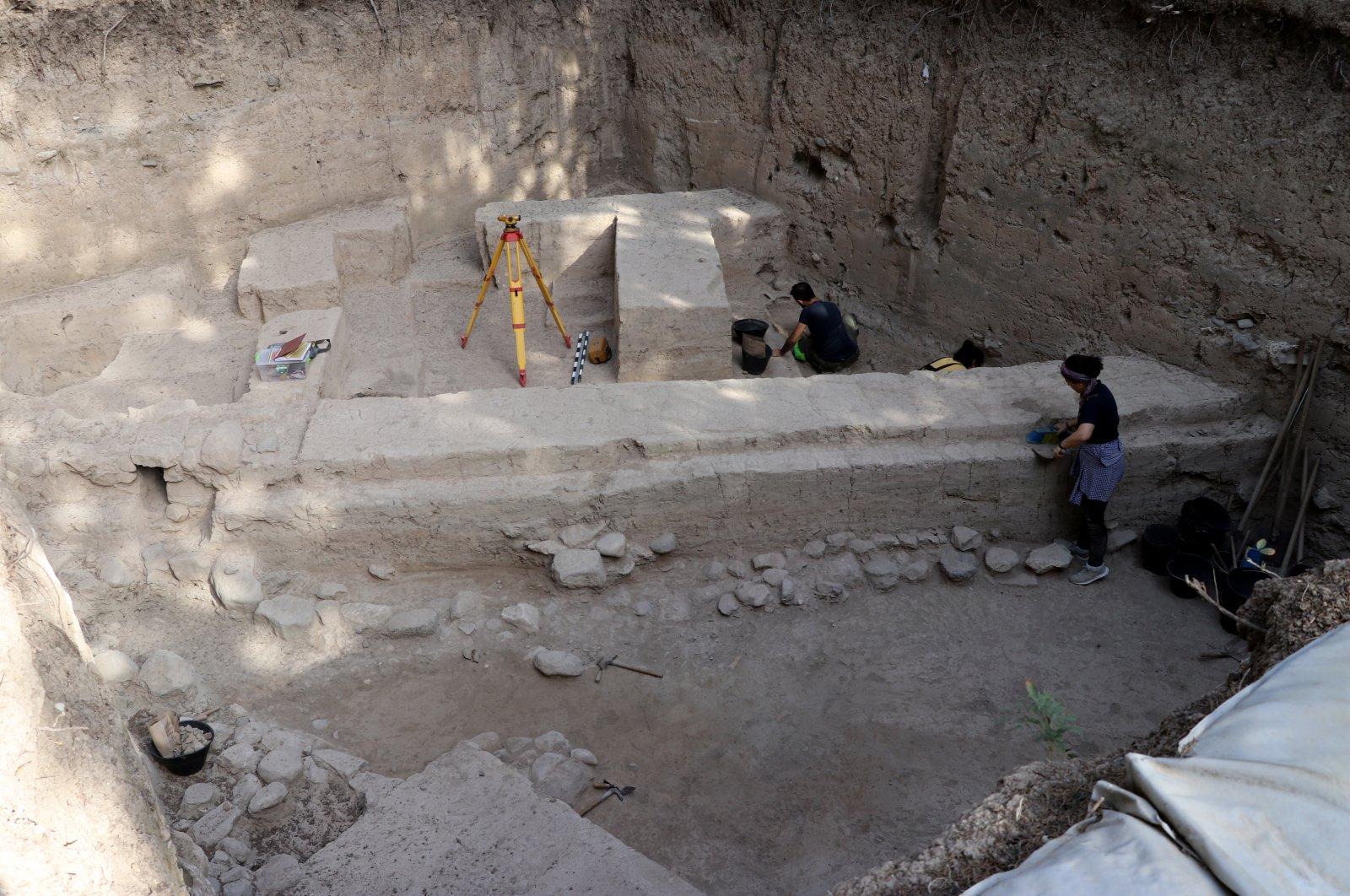 Archaeologists work in Aççana Mound, Hatay, southern Turkey, July 15, 2021. (AA Photo)