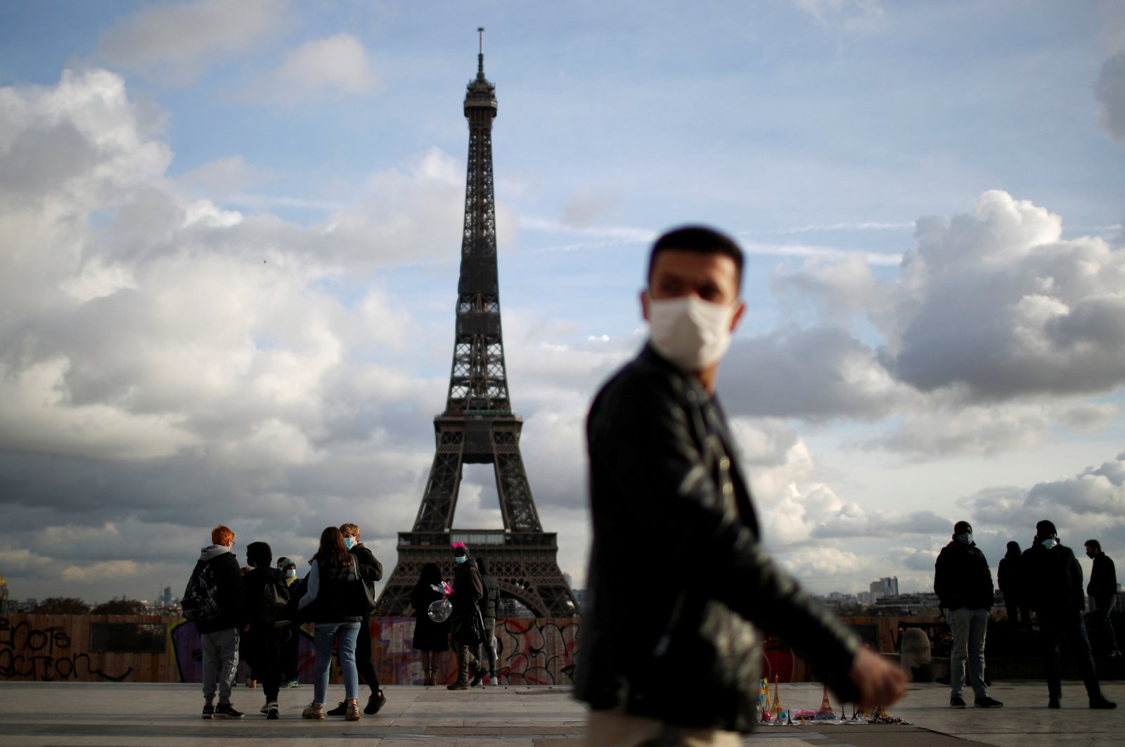 A man wearing a protective face mask walks at Trocadero square near the Eiffel Tower in Paris amid the coronavirus disease outbreak in France, January 22, 2021. (Reuters Photo)