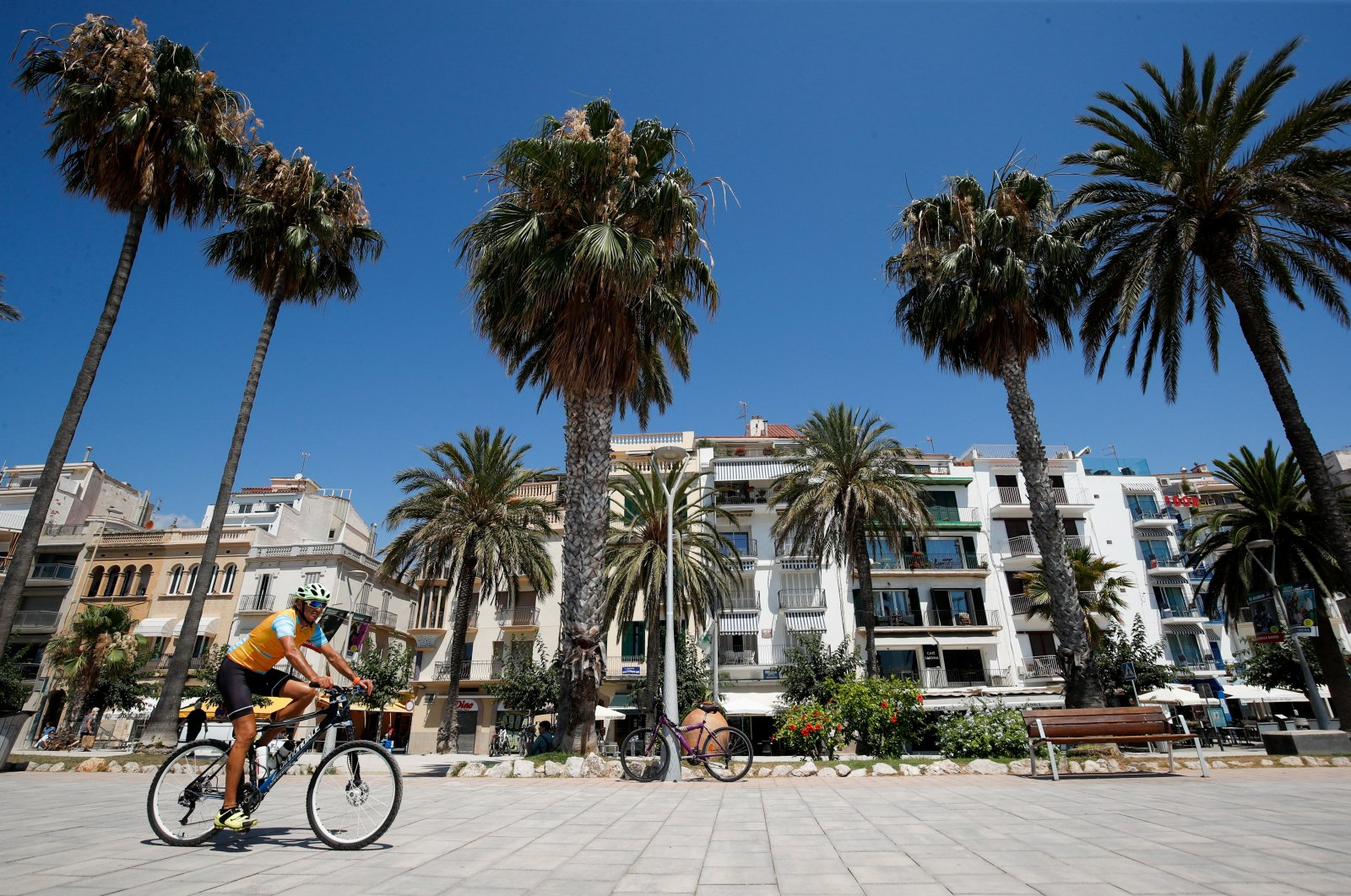 A man rides a bike at a pedestrian area in Sitges town, south of Barcelona, Spain, July 15, 2021. (Reuters Photo)