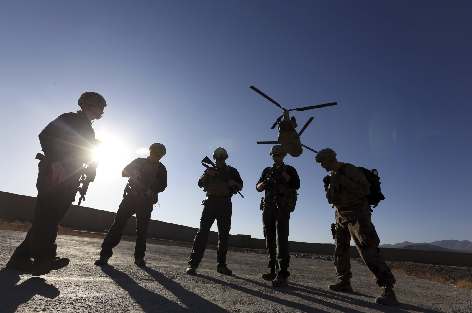 American soldiers wait on the tarmac in Logar province, Afghanistan, Nov. 30, 2017. (AP File Photo)