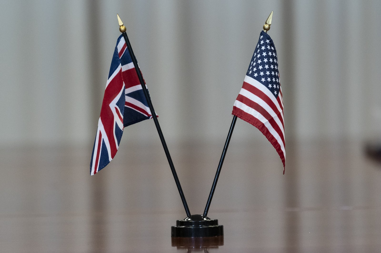 The flags of both countries are seen on the table during a meeting with Secretary of Defense Lloyd Austin and the United Kingdom Secretary of State for Defense Ben Wallace at the Pentagon, Monday, July 12, 2021, in Washington. (AP Photo/Alex Brandon)