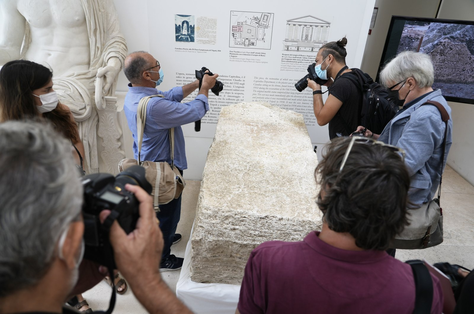 Photographers take pictures during the presentation to the press of an archeological finding that emerged during the excavations at a Mausoleum in Rome, Friday, July 16, 2021. (AP Photo/Domenico Stinellis)
