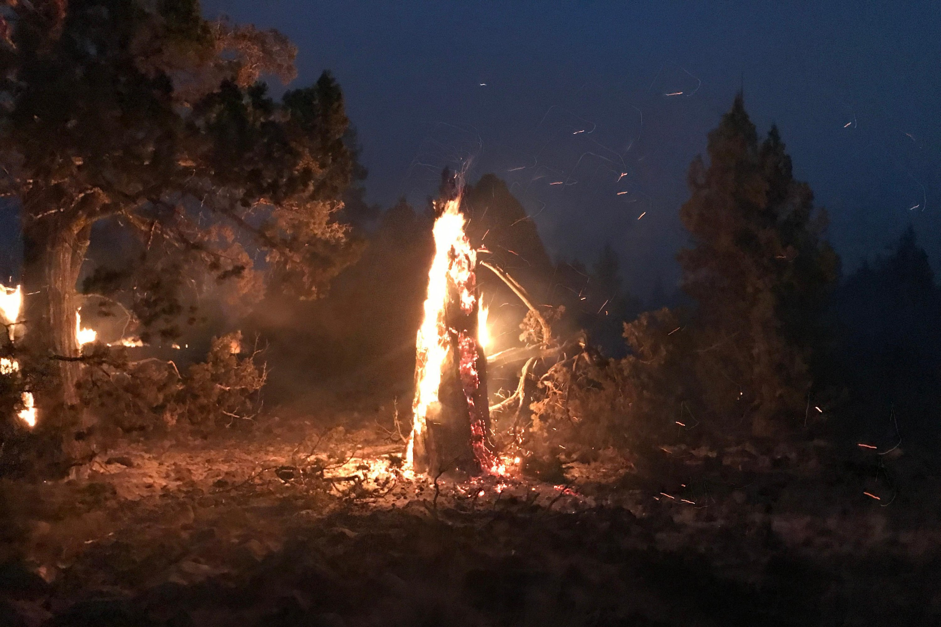 In this photo provided by the Bootleg Fire Incident Command, the Bootleg Fire burns at night near Highway 34 in southern Oregon, U.S., July 15, 2021. (AP Photo)