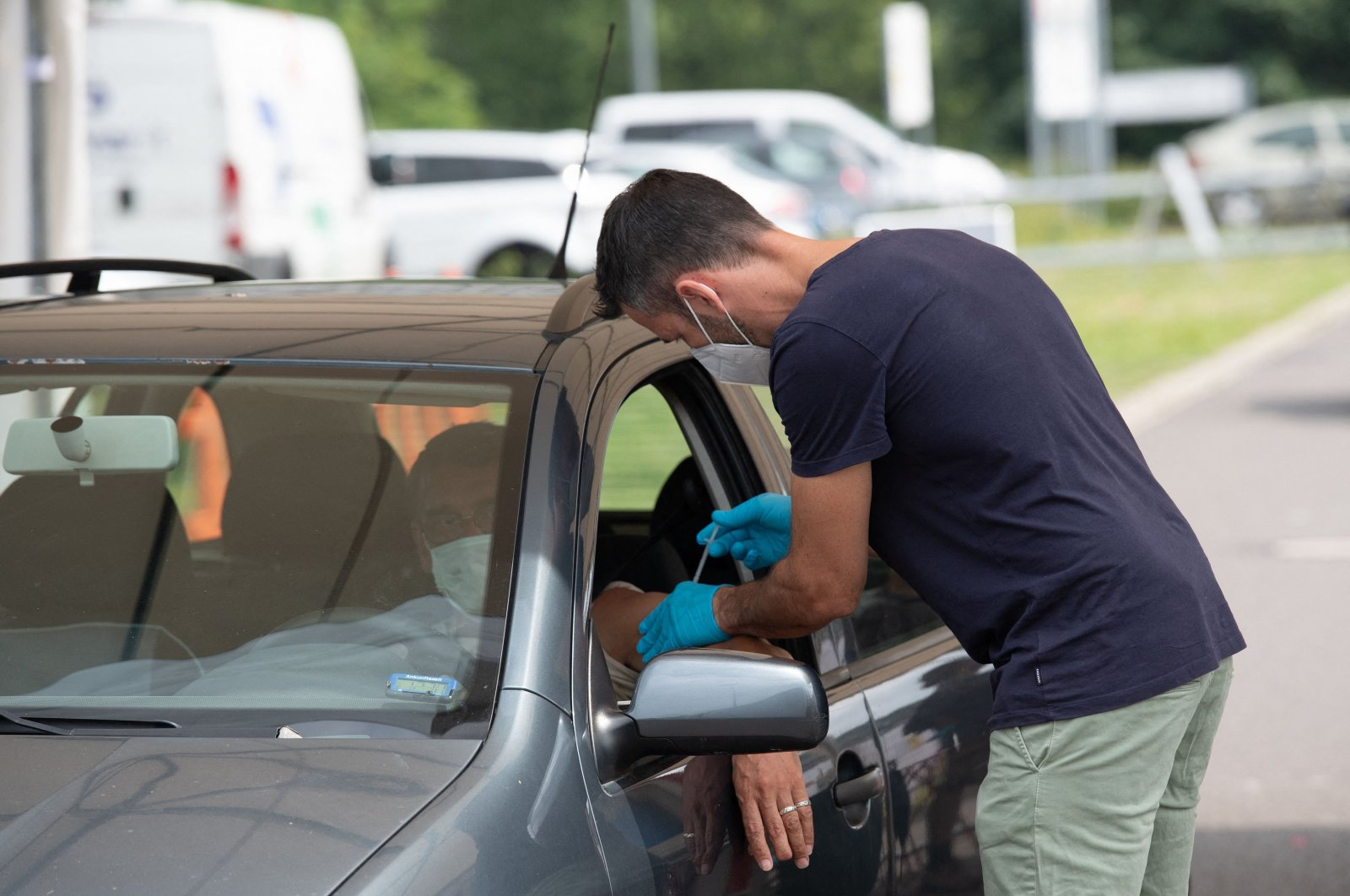 A man is vaccinated in his car at Berlin's first drive-thru vaccination center against the COVID-19, Berlin, Germany, July 17, 2021. (AFP Photo)