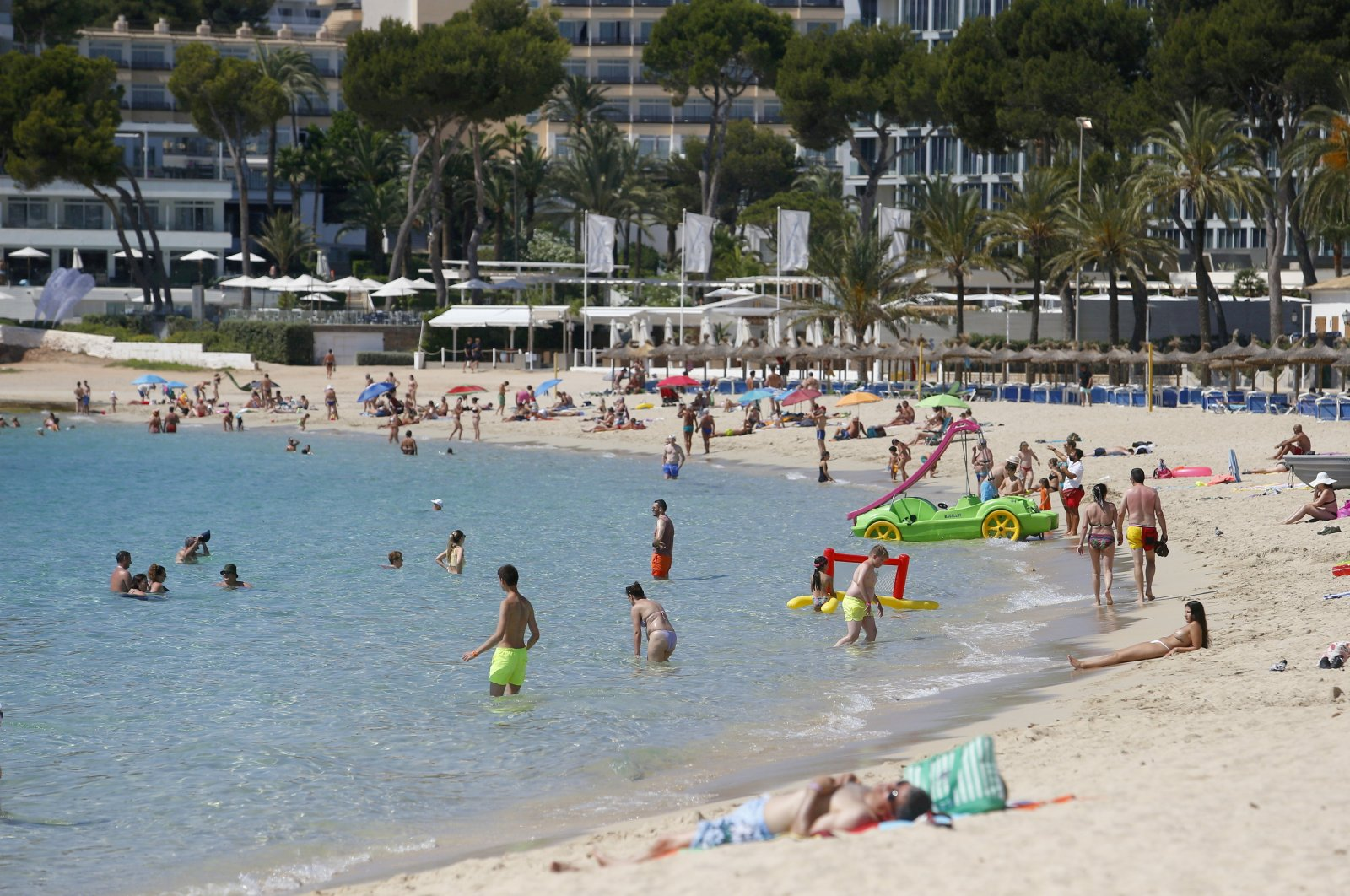 People enjoy themselves at Magaluf beach in Mallorca as British tourists are expected to resume travels to the area starting from June 30th, Spain, June 29, 2021. (Reuters Photo)