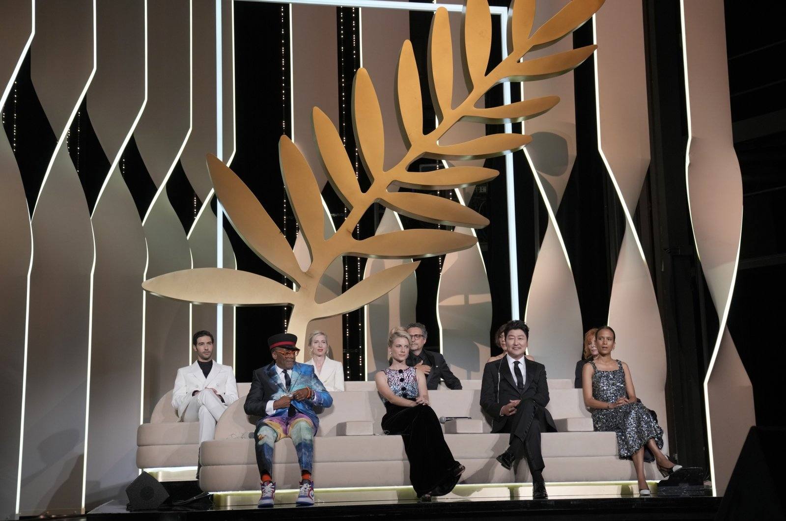 Jury members Tahar Rahim, from back left, Jessica Hausner, Kleber Mendonca Filho, Mylene Farmer, Spike Lee, from bottom left, Melanie Laurent, Song Kang-ho, and Mati Diop appear during the awards ceremony at the 74th international film festival, Cannes, southern France, July 17, 2021. (AP Photo)