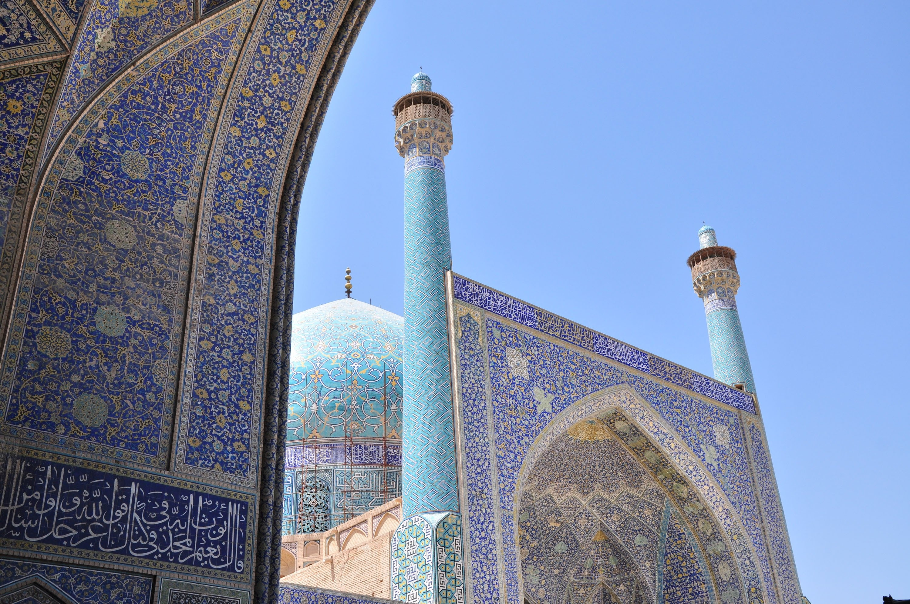 Historical engravings can be seen on the walls of the Jameh Mosque, a grand, congregational mosque whose south dome was built by Nizam al-Mulk, in Isfahan, Iran. (Shutterstock Photo)