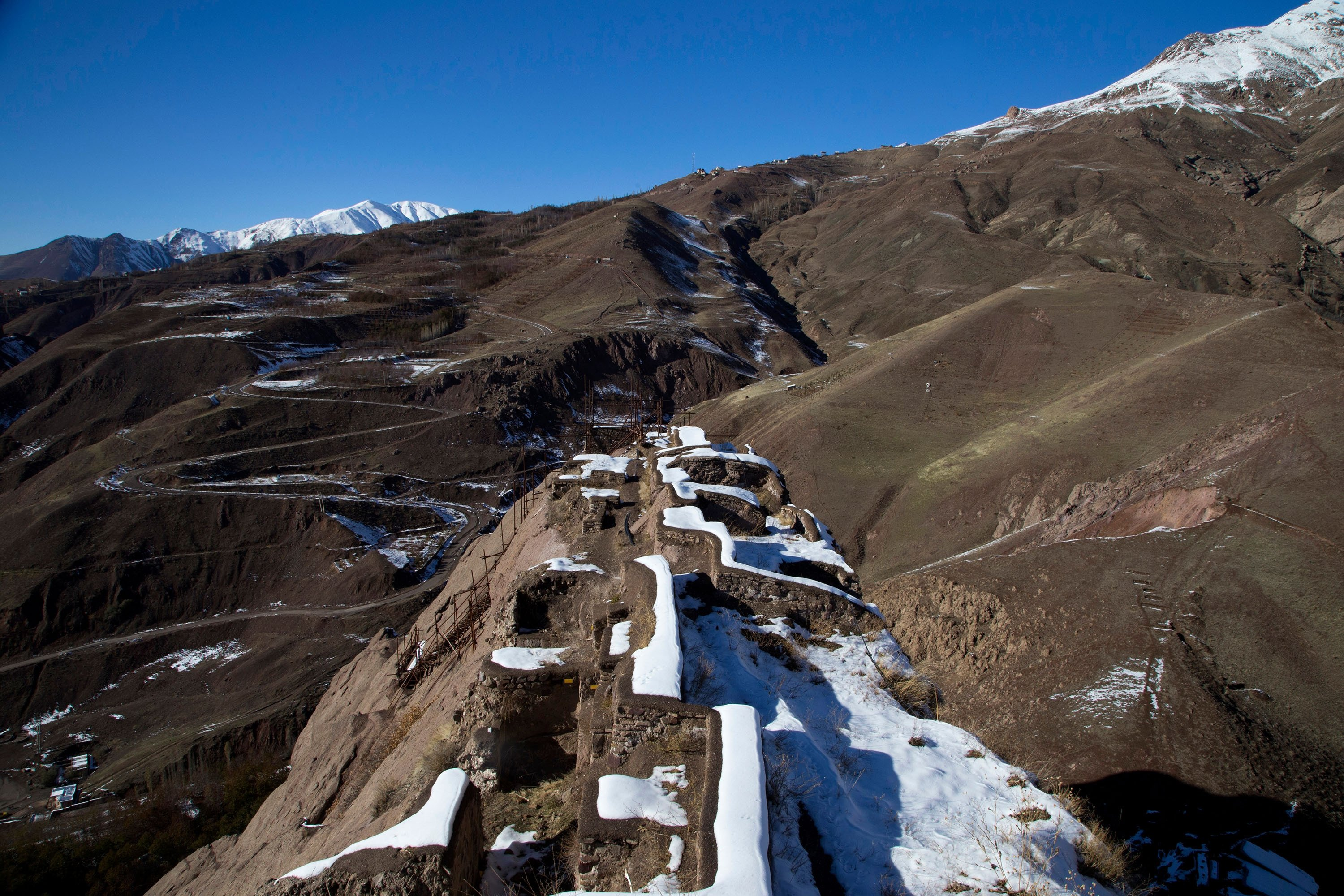 Snow covers the ruins of the Alamut Castle, on a mountain in the Alamut region, Iran. (Shutterstock Photo)