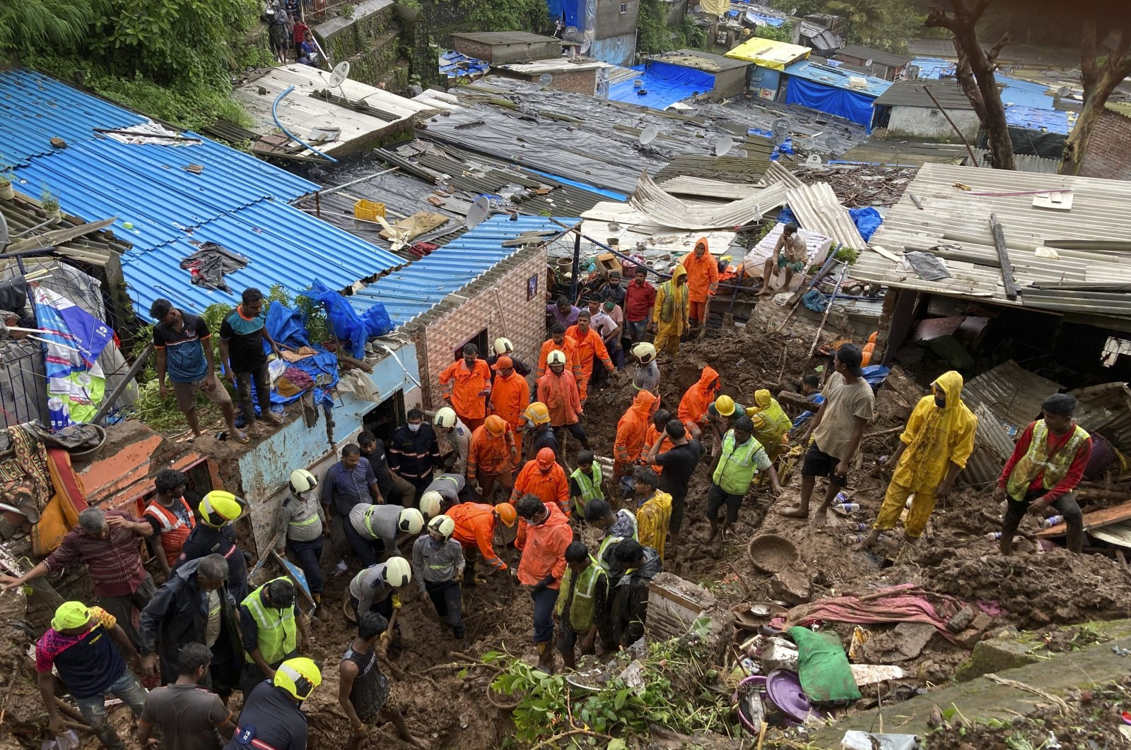 Rescuers look for survivors after a wall collapsed on several slum houses due to heavy monsoon rains in the Mahul area of Mumbai, India, Sunday, July 18, 2021. (AP Photo)