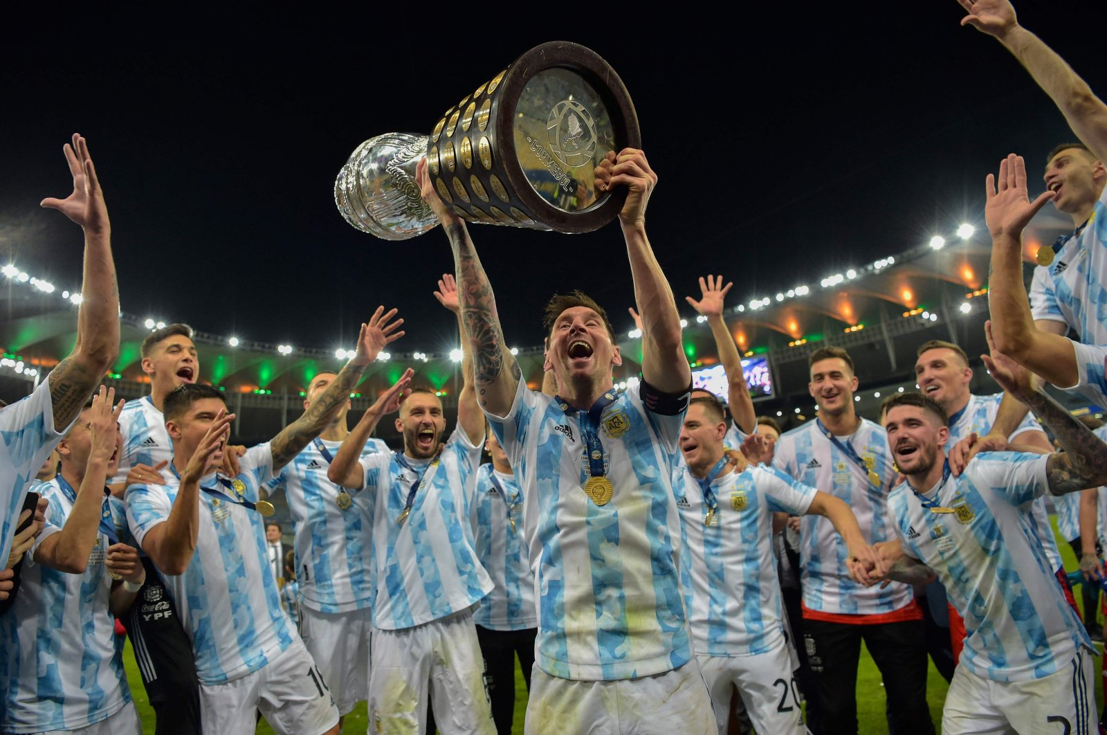 Argentina's Lionel Messi lifts the Copa America trophy as he celebrates with teammates after winning the final against Brazil at Maracana Stadium in Rio de Janeiro, Brazil, July 10, 2021. (AFP Photo)