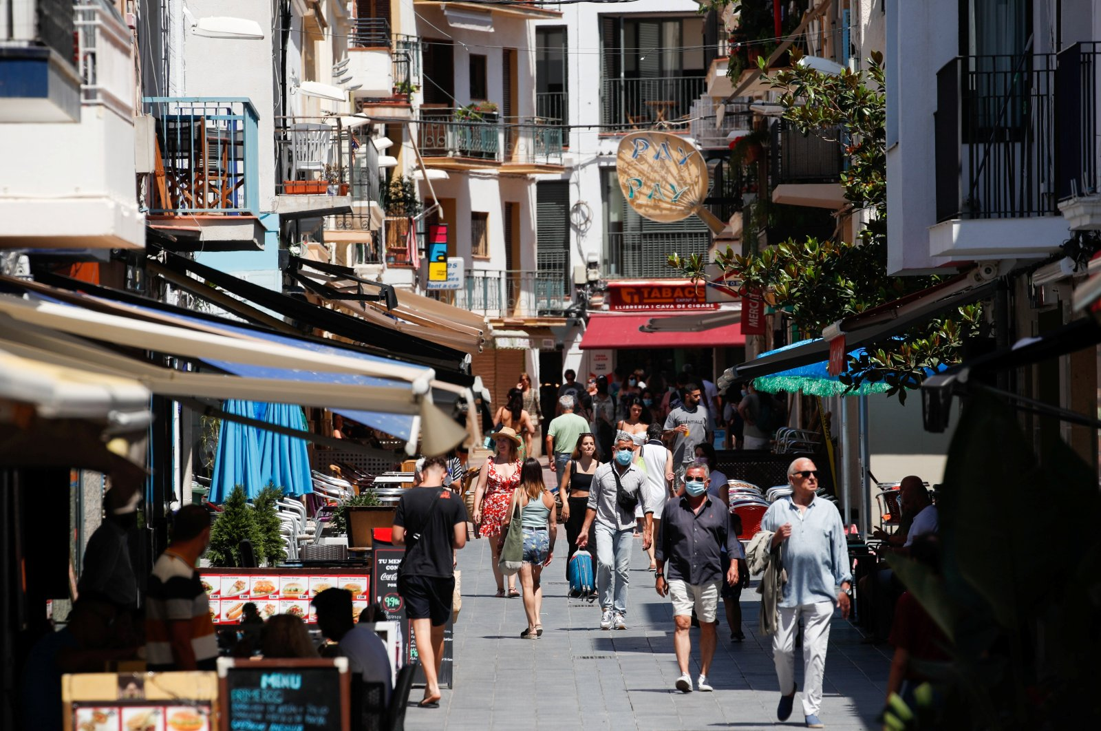 People walk in a pedestrian area in Sitges town, south of Barcelona, Spain, July 15, 2021. (Reuters Photo)