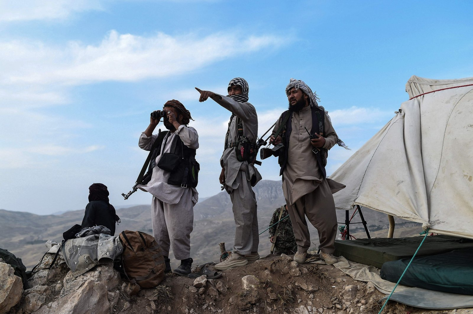 Afghan militia fighters keep a watch at an outpost against Taliban insurgents at Charkint district in Balkh Province, Afghanistan, July 15, 2021. (AFP Photo)