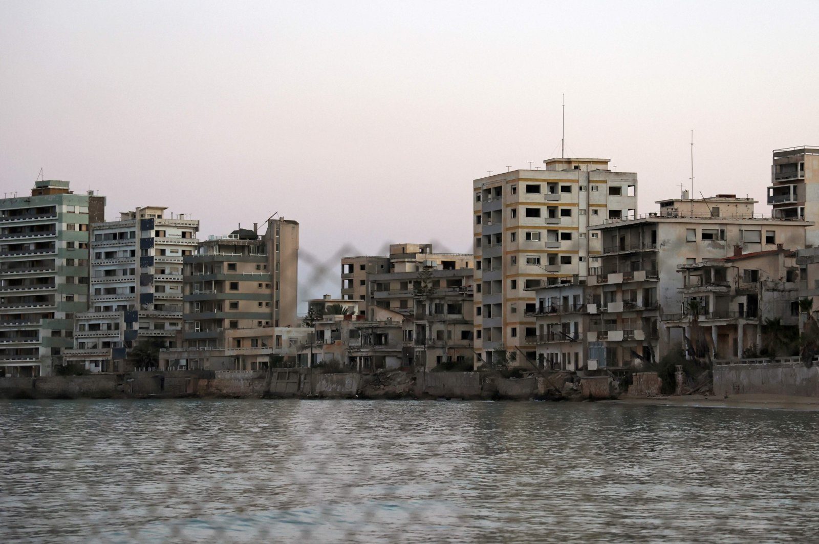A view shows abandoned buildings and hotels in the fenced-off area of Varosha in the town of Famagusta in the Turkish Republic of Northern Cyprus (TRNC) of the divided Mediterranean island of Cyprus, July 16, 2021. (AFP Photo)