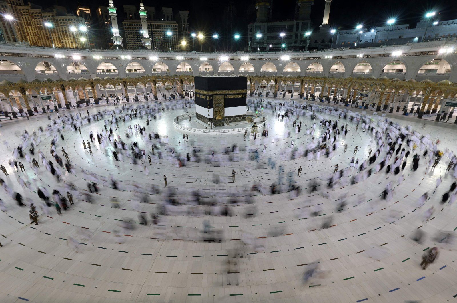 A long exposure photograph shows Muslim pilgrims circumambulating around the Kaaba, Islam's holiest shrine, at the Grand Mosque in the holy Saudi Arabian city of Mecca during the annual hajj pilgrimage, July 17, 2021. (AFP Photo)