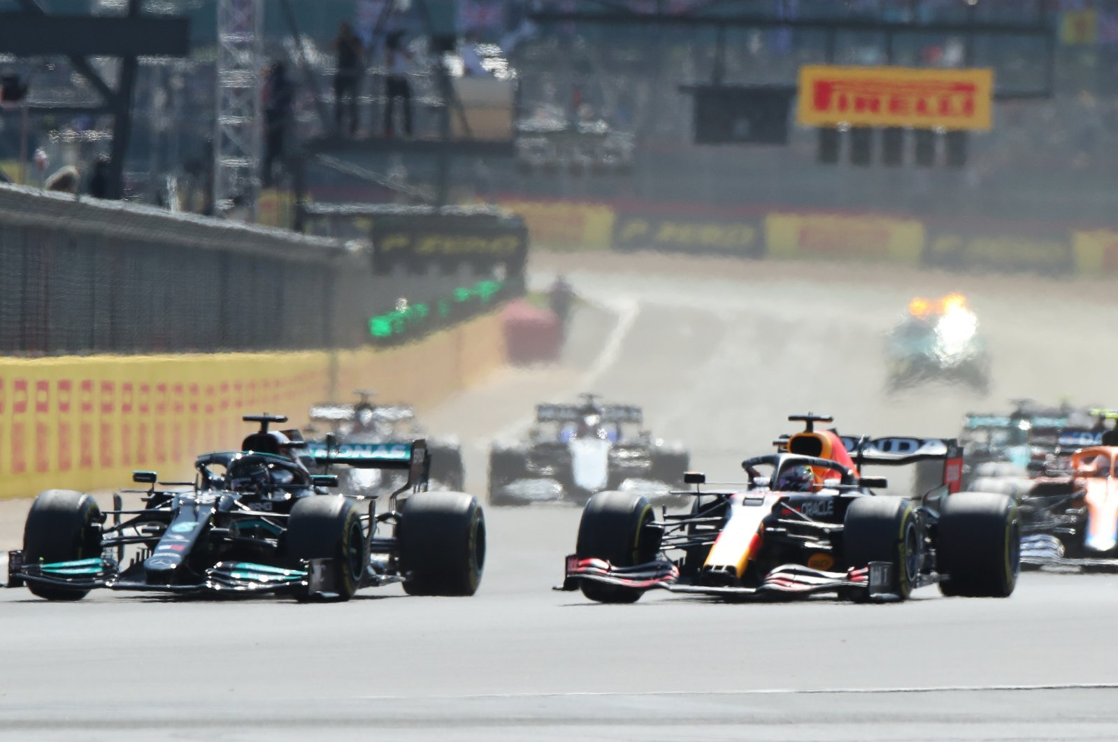 Red Bull's Max Verstappen leads at the start of the British Grand Prix ahead of Mercedes' Lewis Hamilton, Silverstone Circuit, Silverstone, England, July 18, 2021. (Reuters Photo)
