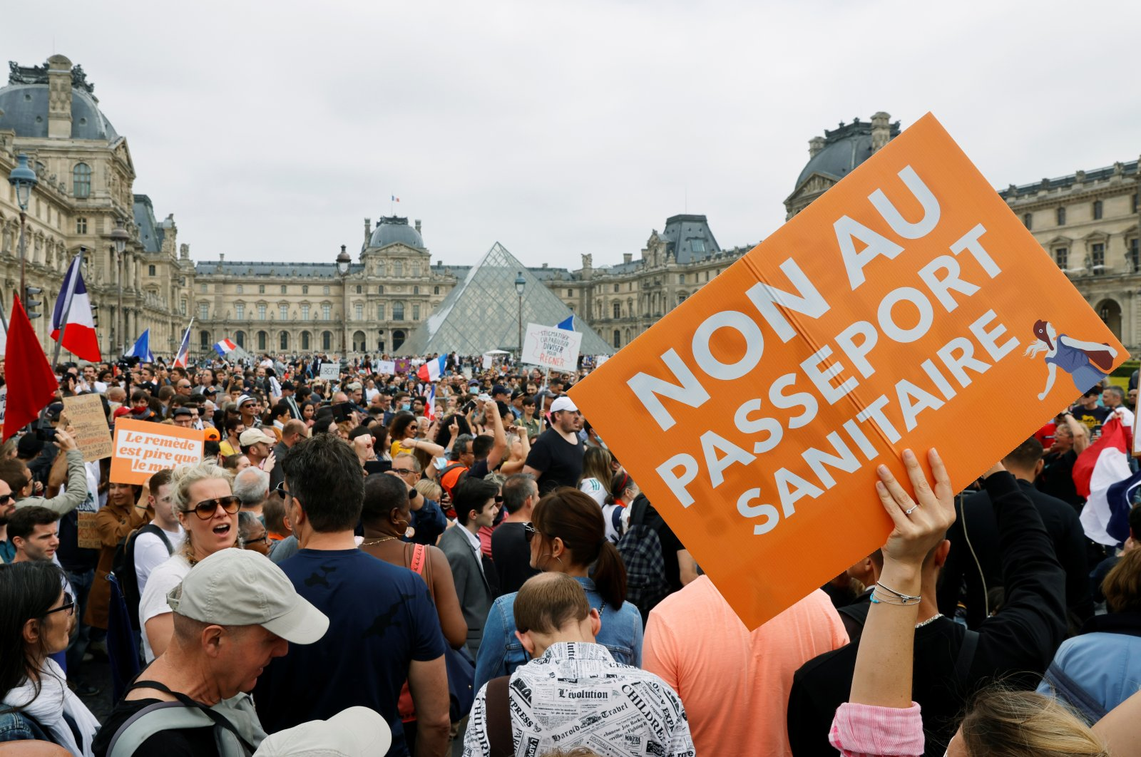 Demonstrators attend a protest against the new measures announced by French President Emmanuel Macron to fight the coronavirus disease (COVID-19) outbreak, in Paris, France, July 17, 2021. (REUTERS Photo)