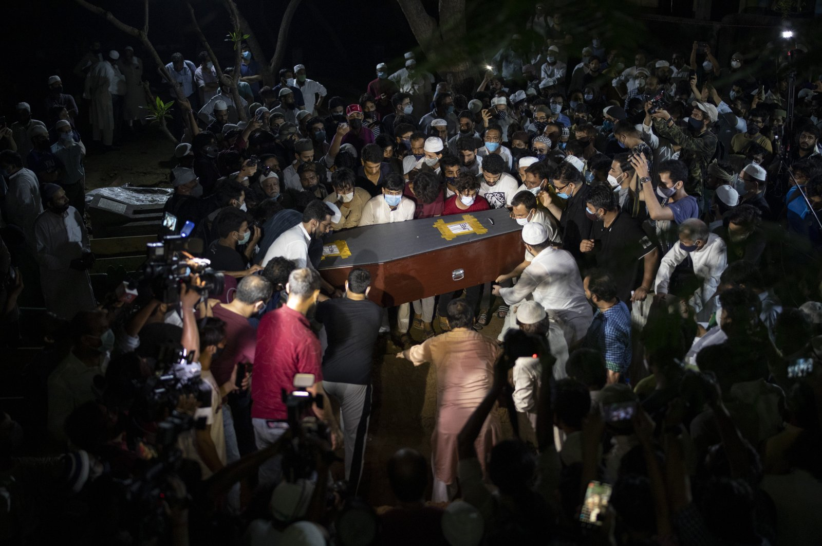 People carry the coffin of Reuters photographer Danish Siddiqui during his funeral in New Delhi, India, July 18, 2021. (AP Photo)