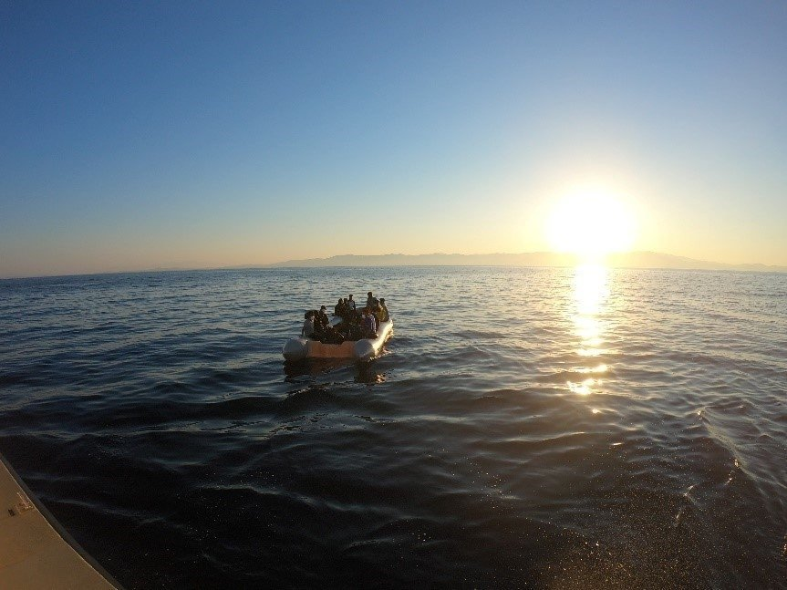 31 irregular migrants are seen in a boat pushed back by Greece off Izmir province's Dikili district, July 15, 2021. (IHA Photo)