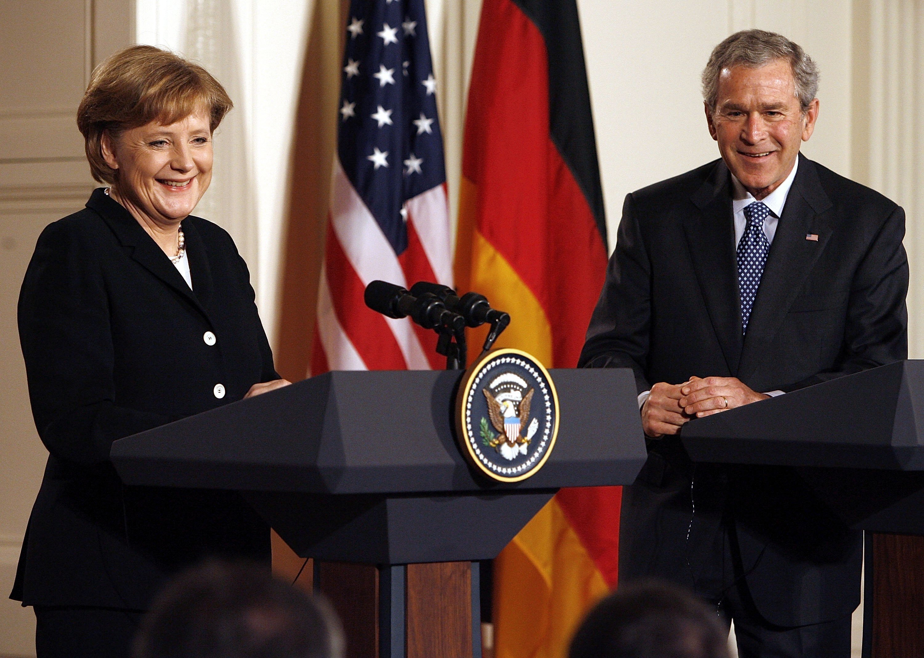 German Chancellor Angela Merkel (L) and then U.S. President George W. Bush hold a joint press conference in the East Room of the White House in Washington, D.C., U.S., Jan. 13, 2006. (Getty Images Photo)