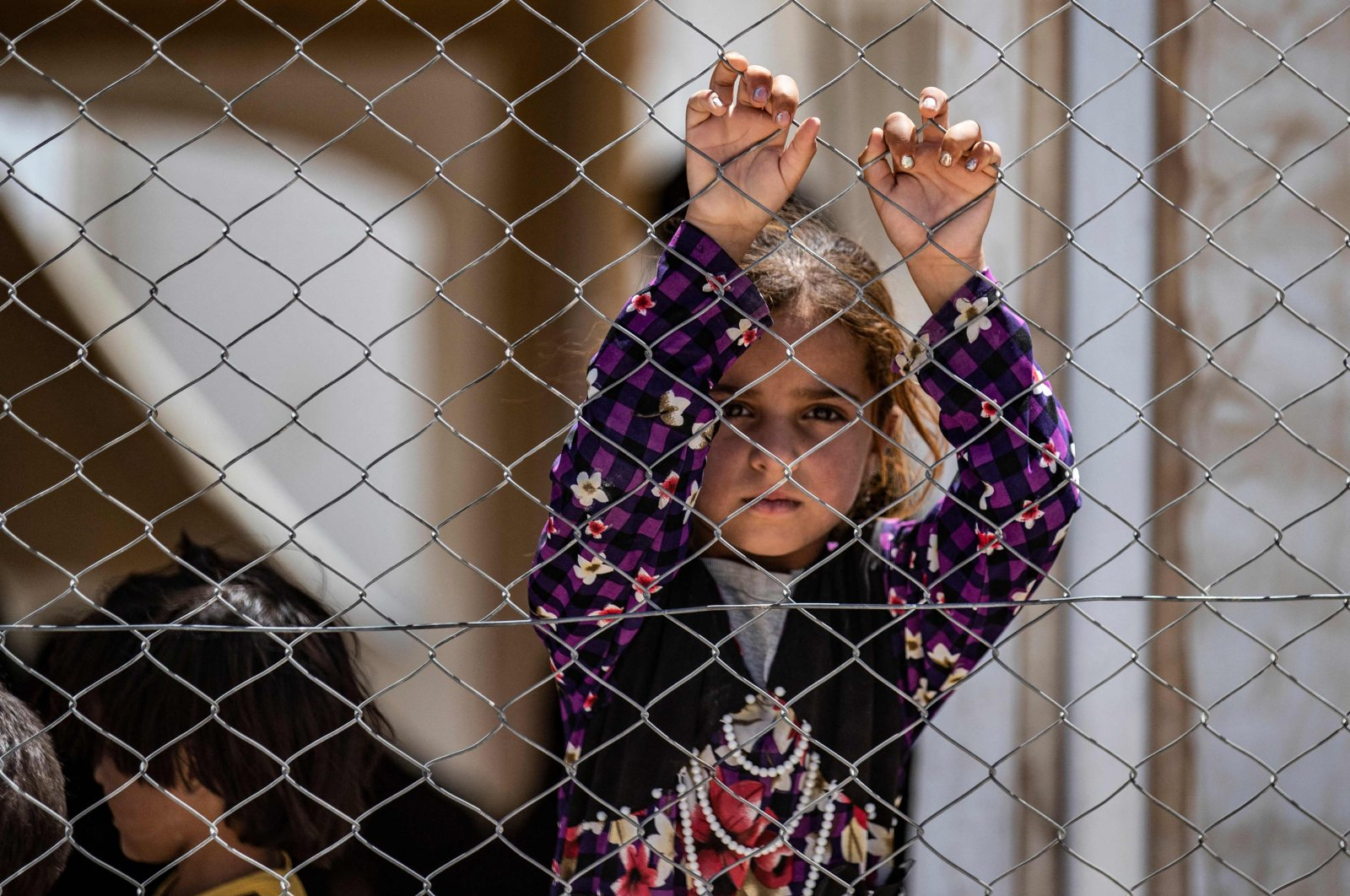 A Syrian child waits with family members inside the al-Hol camp, which holds relatives of suspected Daesh fighters in the northeastern Hasakeh governorate, Syria, July 15, 2021. (AFP Photo)