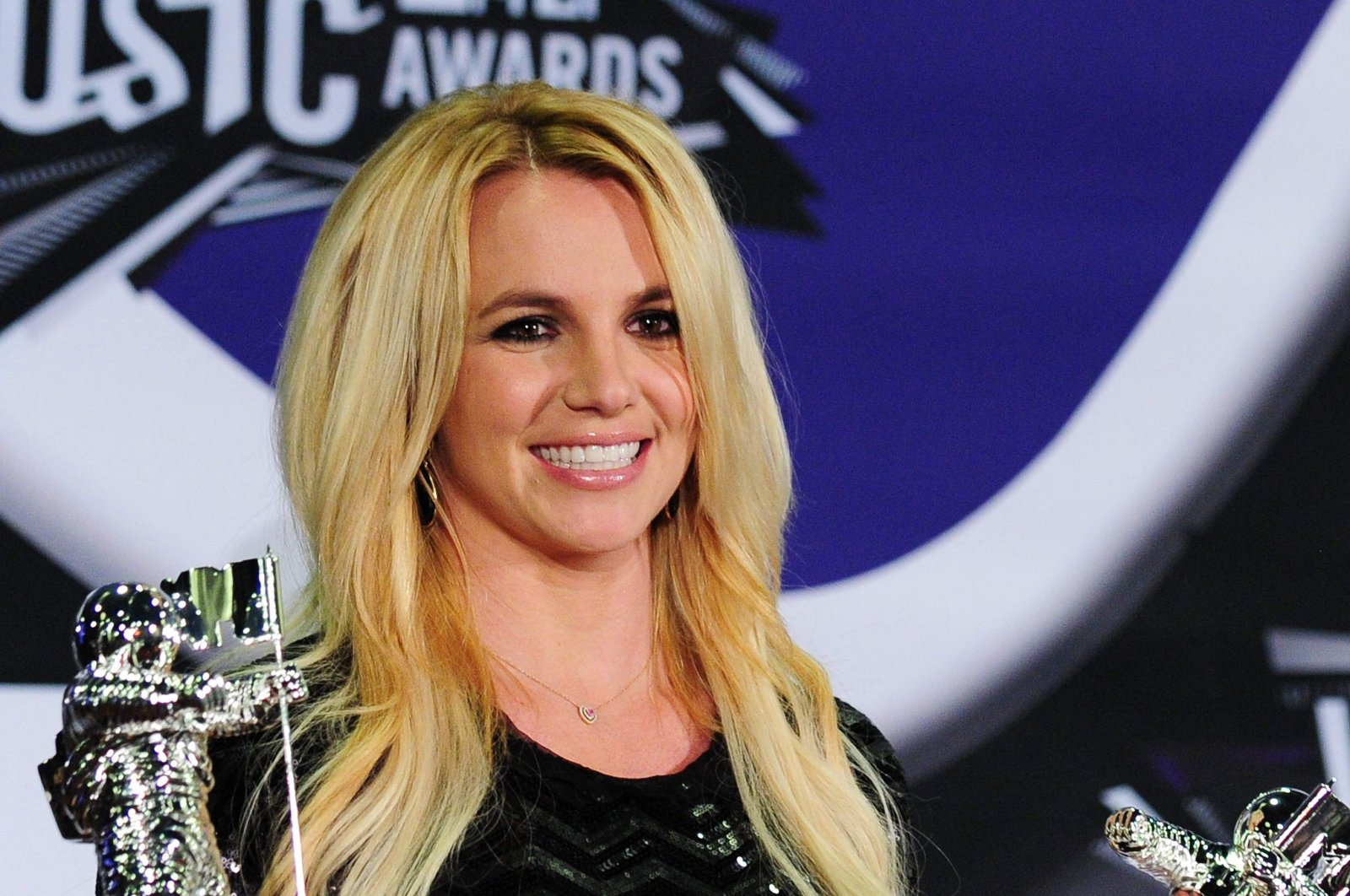 In this file photo Britney Spears holds her Best Pop Video Award and her Michael Jackson Video Vanguard Award in the press room at the 2011 MTV Video Music Awards (VMAs) August 28, 2011 at the Noika Theatre in downtown Los Angeles, California. (AFP Photo)