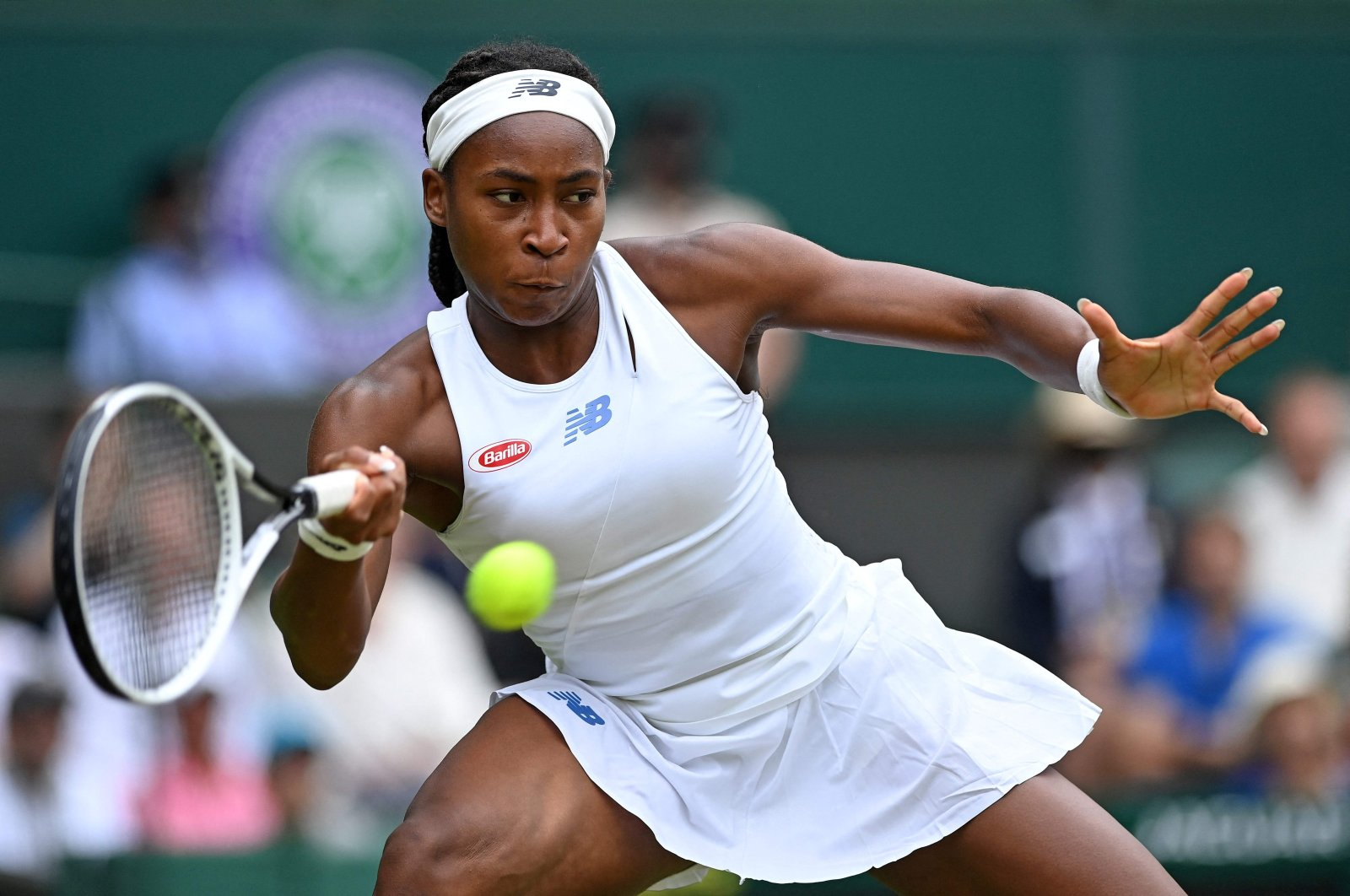 U.S. player Coco Gauff returns against Germany's Angelique Kerber during their Wimbledon women's singles fourth-round match at The All England Tennis Club in Wimbledon, southwest London, July 5, 2021.