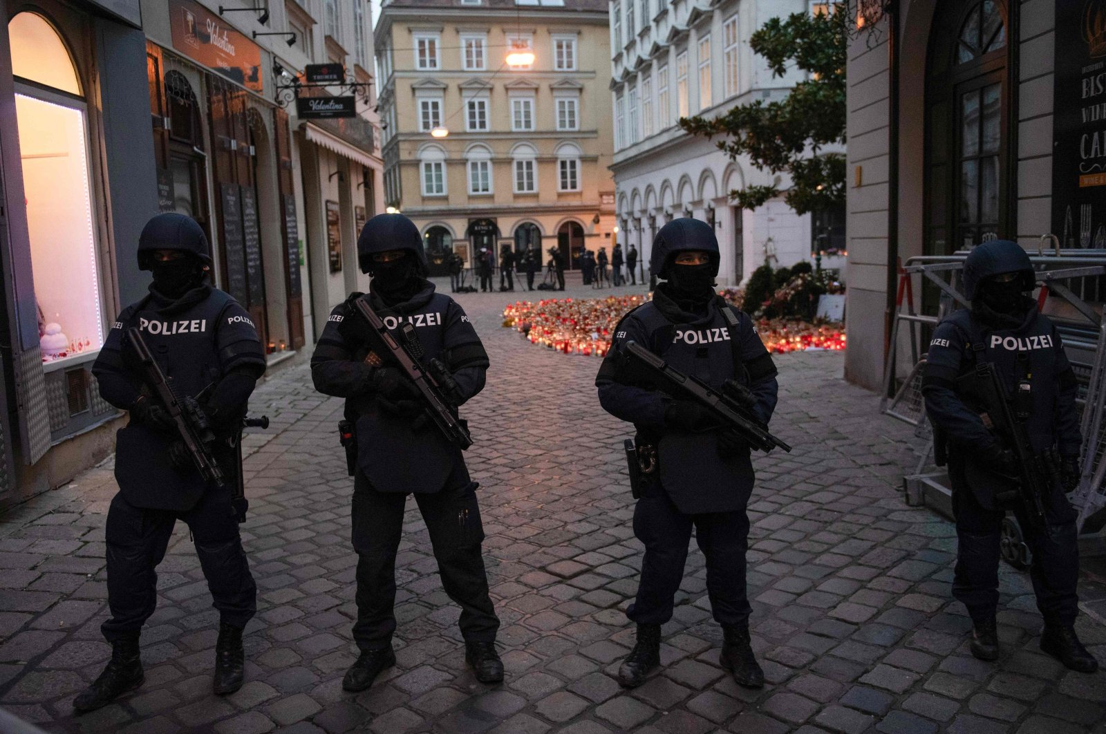 Armed police officers stand guard before the arrival of Austrian Chancellor Kurz and European Council President Charles Michel for a visit to pay respects to the victims of the terrorist attack in Vienna, Austria, Nov. 9, 2020. (AFP Photo)
