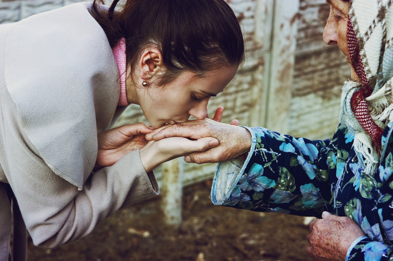 A young girl presents her bayram greeting by kissing the hand of an elder. (Shutterstock Photo)