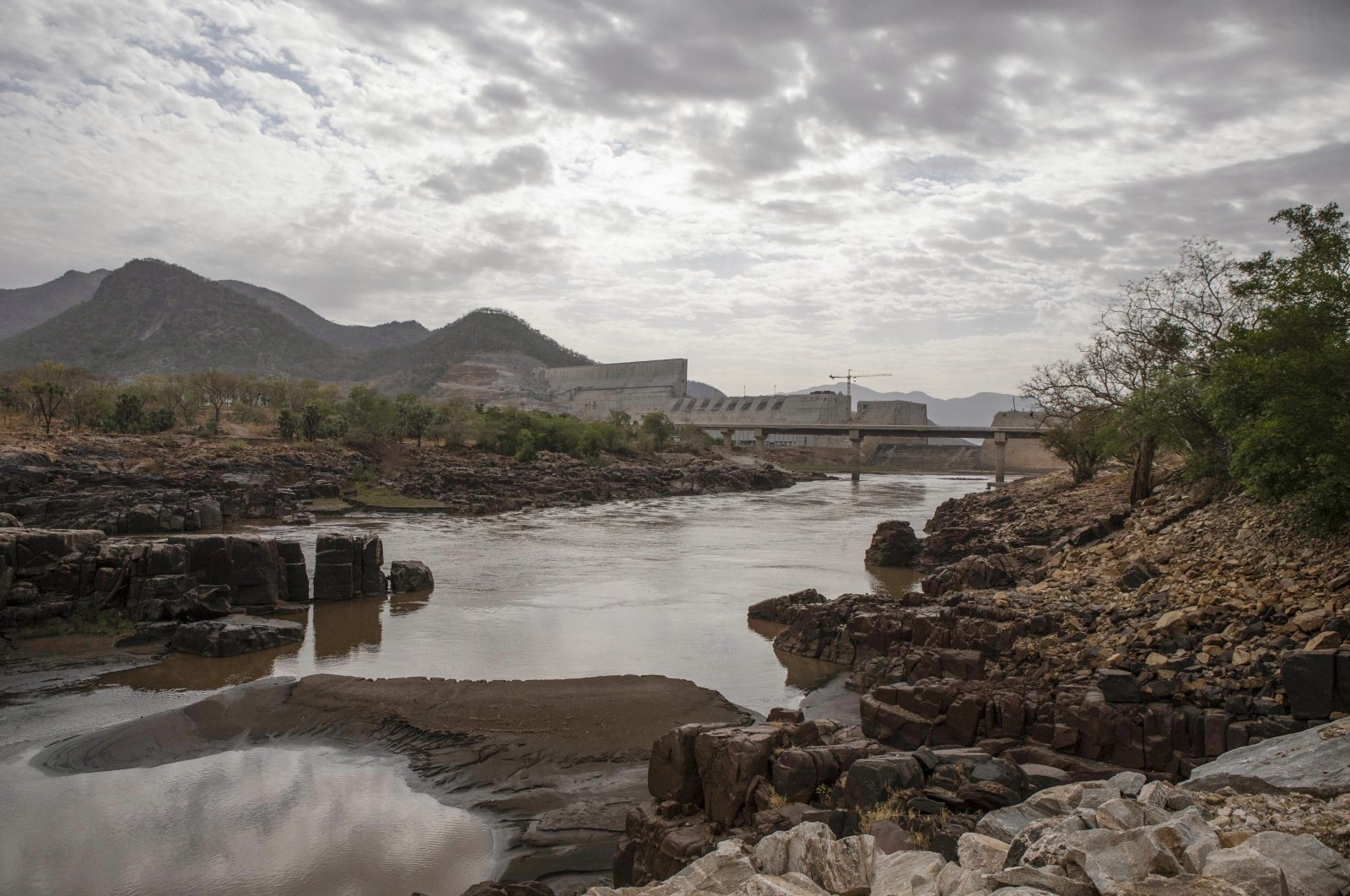 The Blue Nile flows as the under-construction Grand Ethiopian Renaissance Dam stands beyond in the Benishangul-Gumuz Region of Ethiopia, May 22, 2019. (Getty Images)