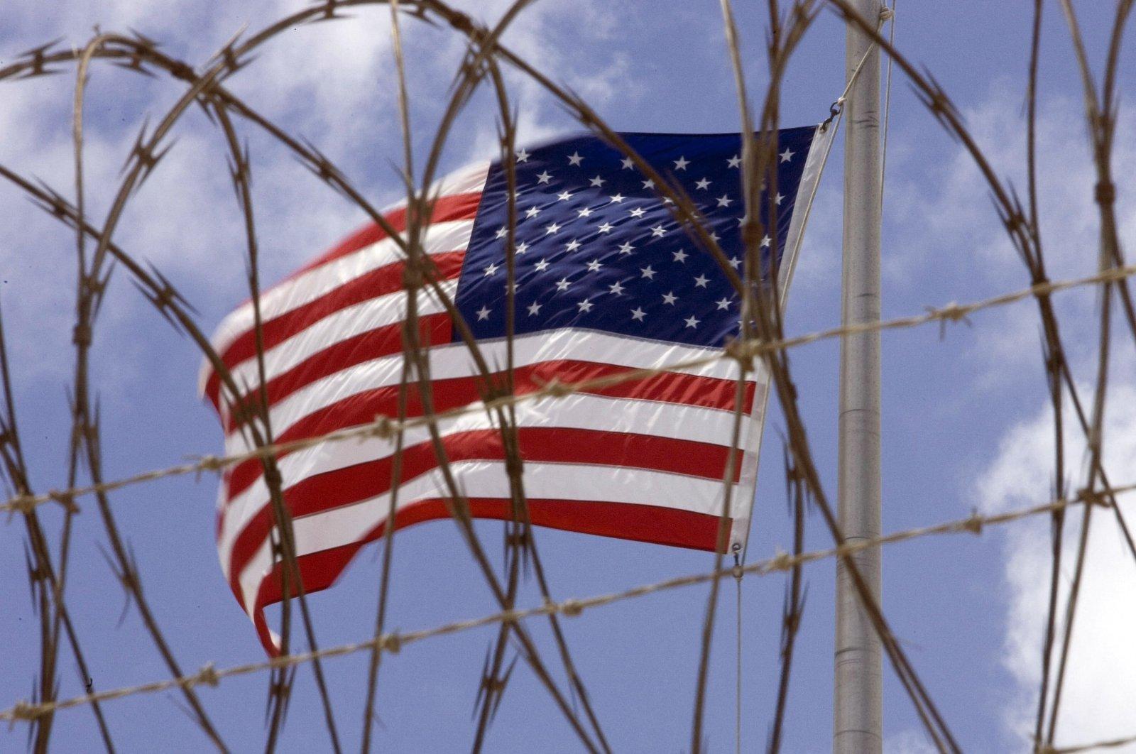 A U.S. flag flies at Camp V inside Camp Delta at the U.S. Naval Station in Guantanamo Bay, Cuba, April 24, 2007. (AFP File Photo)