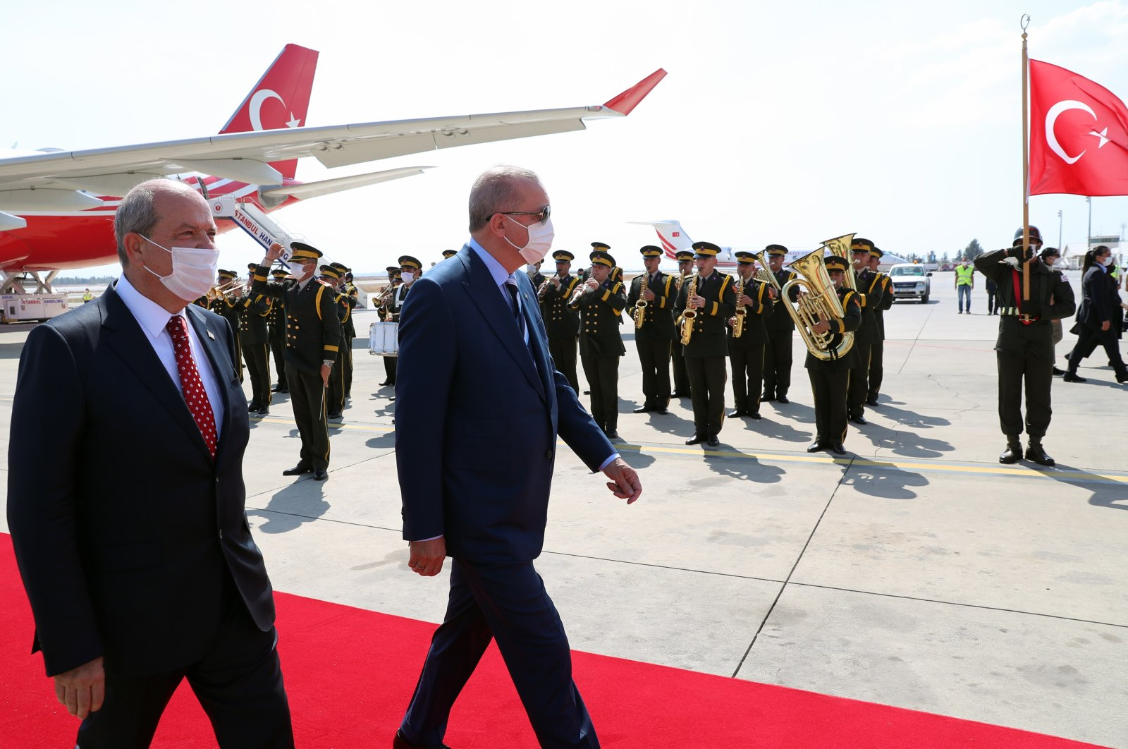 Turkish President Recep Tayyip Erdoğan reviews a guard of honor with Turkish Cypriot leader Ersin Tatar as he arrives to the Turkish Republic of Northern Cyprus (TRNC), in northern Nicosia, Cyprus, July 19, 2021. (AA Photo)
