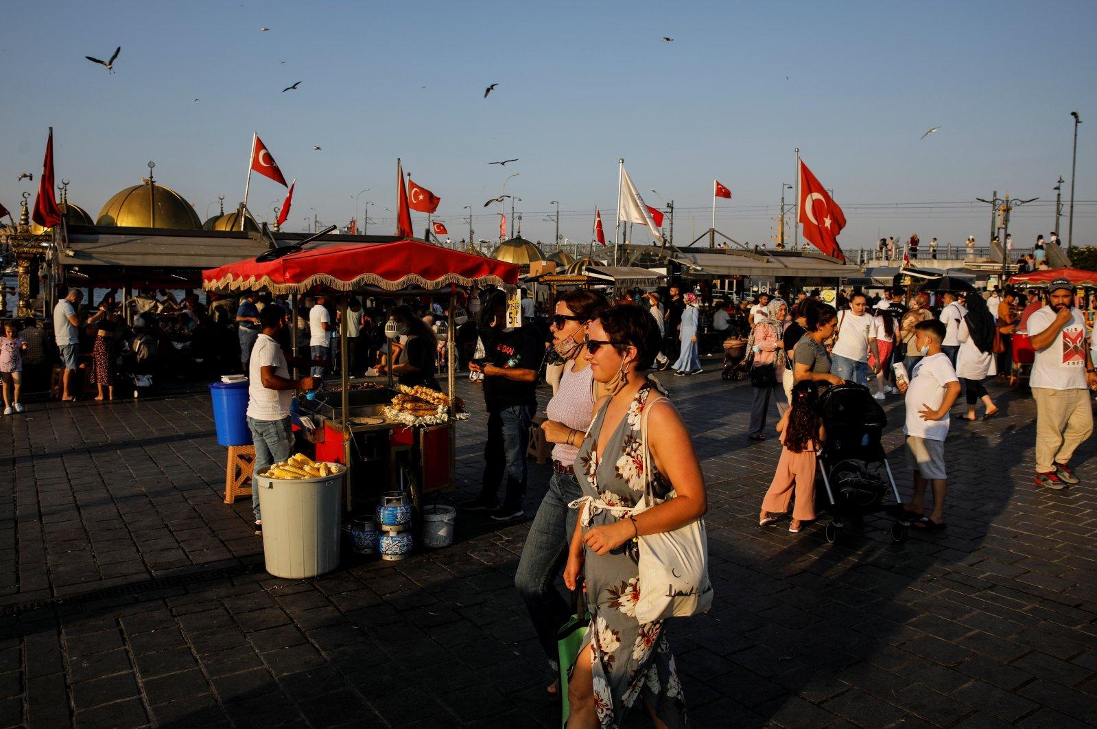 People walk along the Eminönü neighborhood of Istanbul, Turkey, July 12, 2021. (Reuters Photo)