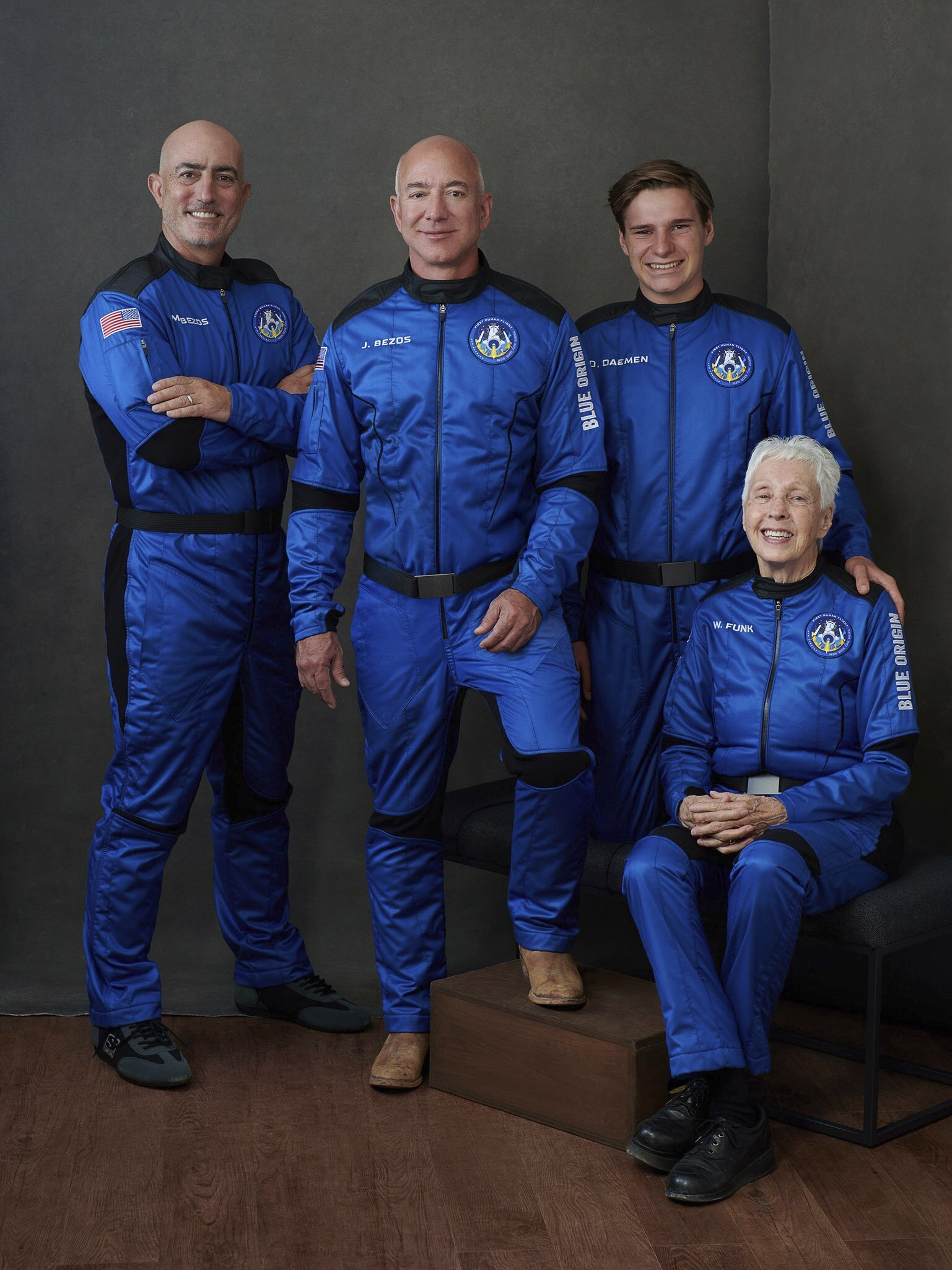 In this photo provided by Blue Origin, (left to right): Mark Bezos, Jeff Bezos, Oliver Daemen and Wally Funk, pose for a photo. (Blue Origin via AP Photo)