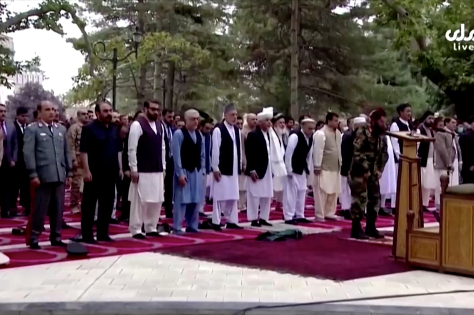 Afghanistan's President Ashraf Ghani (front row) attends Eid al-Adha prayers at the presidential palace, moments before the sounds of rocket explosions can be heard, in Kabul, Afghanistan, July 20, 2021, in this still image taken from TV footage. (Reuters Photo)