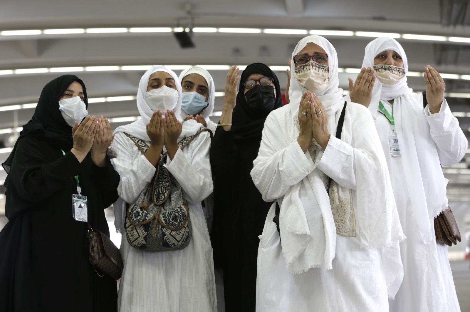 Muslim pilgrims pray during the symbolic stoning of the devil ritual during the hajj pilgrimage in Mina, near the holy city of Mecca, Saudi Arabia, July 20, 2021. (AP Photo)