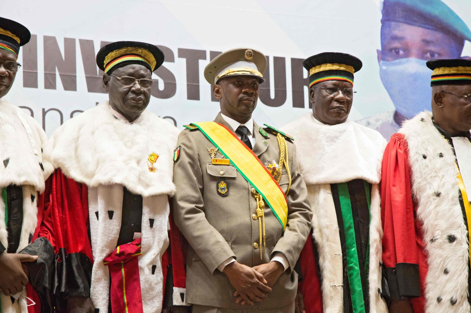 Interim Malian President, Colonel Assimi Goita (C), stands with members of the Supreme Court during his swearing in ceremony in Bamako, Mali, June 7, 2021. (AFP Photo)